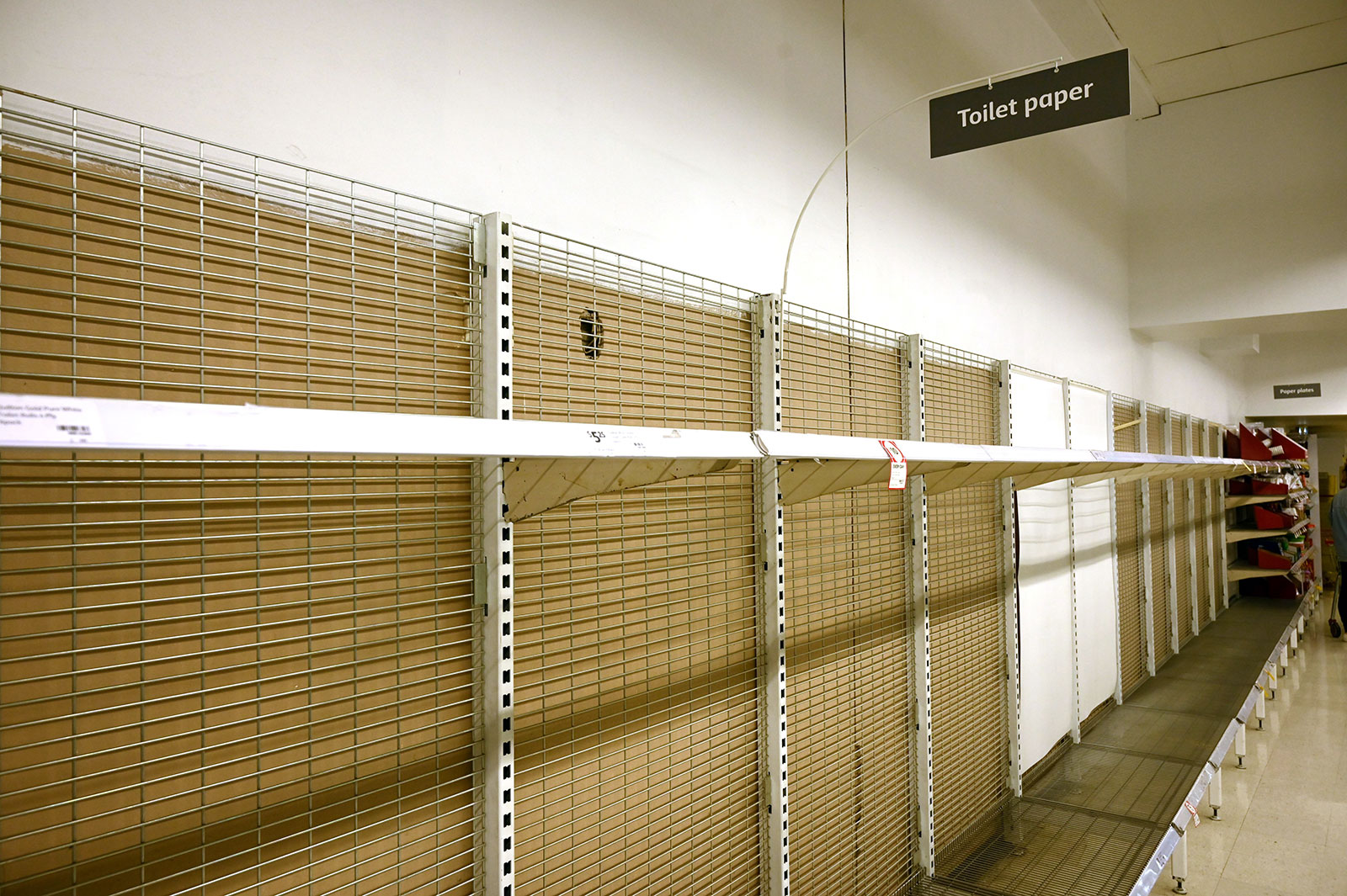 Shelves are empty of toilet rolls in a supermarket in Sydney, Australia on March 4.