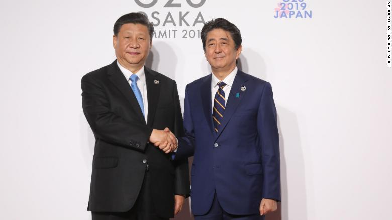 Chinese President Xi Jinping is welcomed by Japanese Prime Minister Shinzo Abe at the G20 summit in Osaka on June 28.