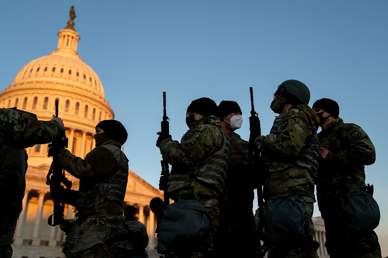 Weapons are distributed to members of the National Guard outside the US Capitol on January 13.