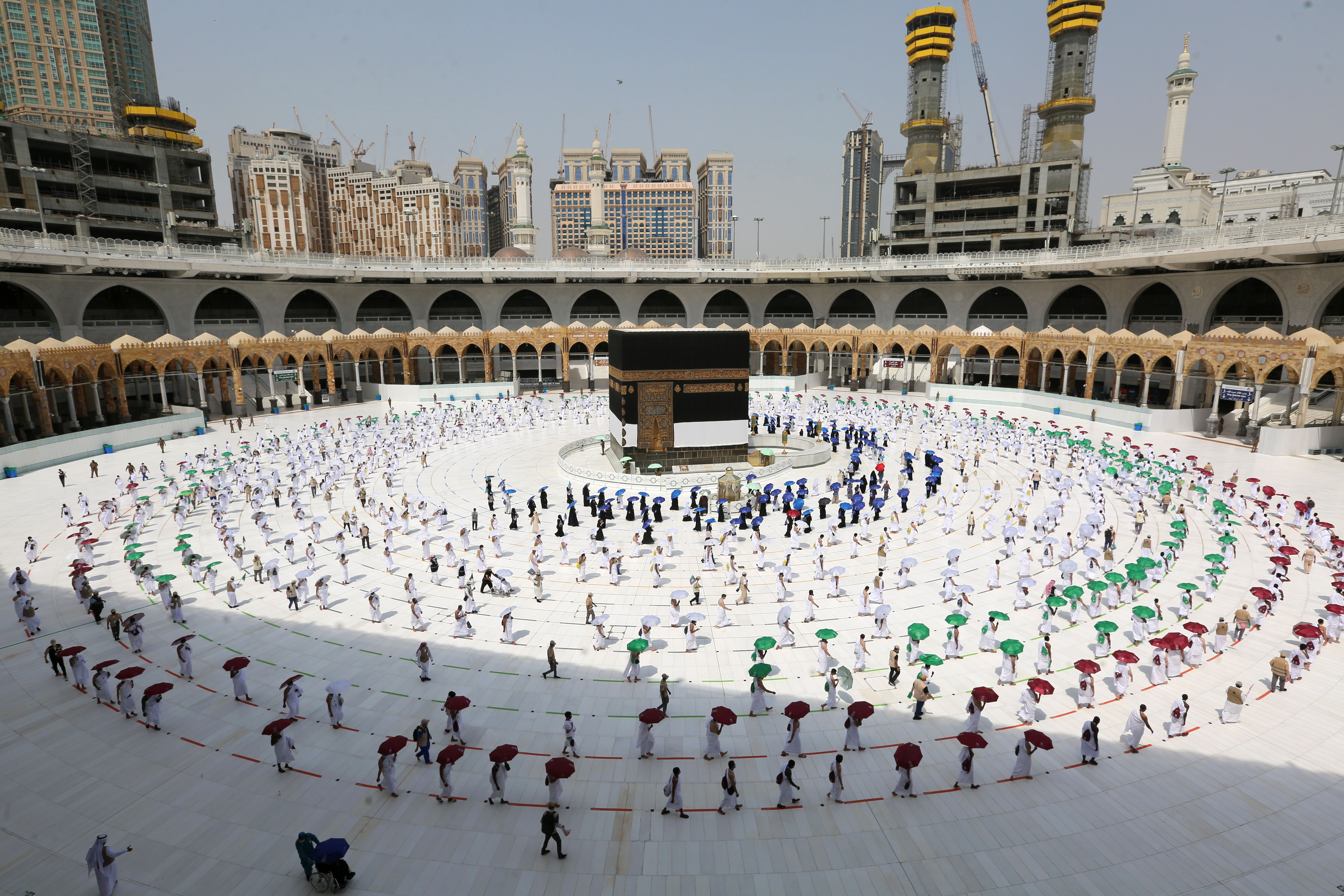 Muslim pilgrims walk around the Kaaba at the center of the Grand Mosque in Mecca, Saudi Arabia, on July 29.