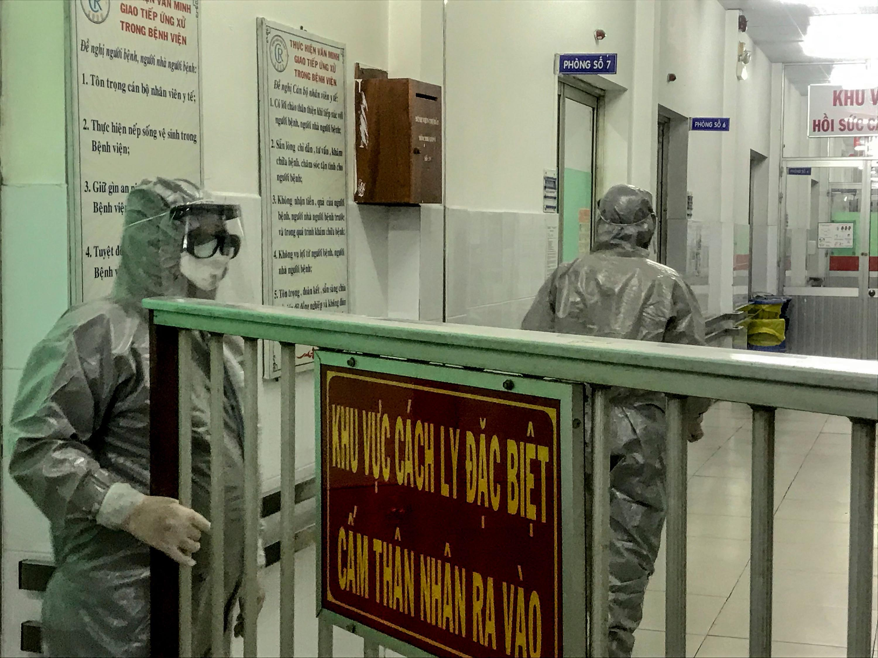 Medical workers enter an isolation area to visit coronavirus patients in Cho Ray hospital in Ho Chi Minh City, Vietnam, on January 23.
