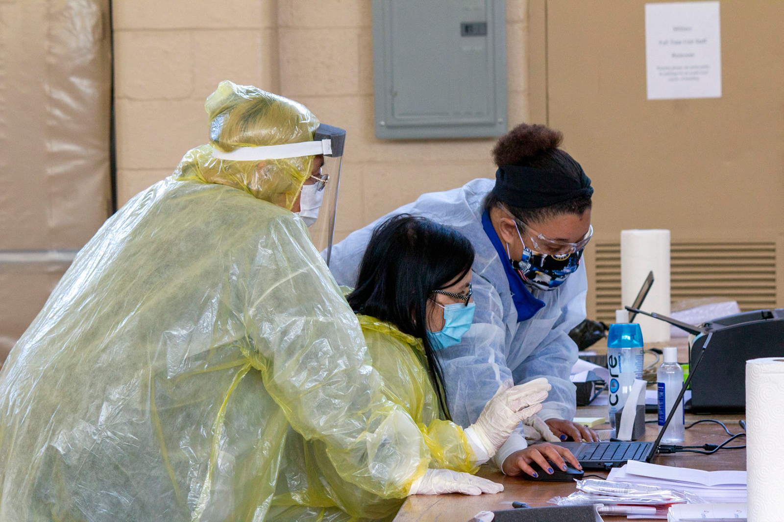 Medical workers with OptumServe Health Services prepare a Covid-19 test sample from a patient inside the National Guard Armory in La Porte, Indiana on May 6.