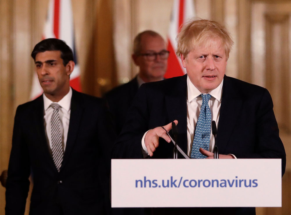 In this file photo from March 17, Prime Minister Boris Johnson arrive for a coronavirus news briefing at 10 Downing Street in London.