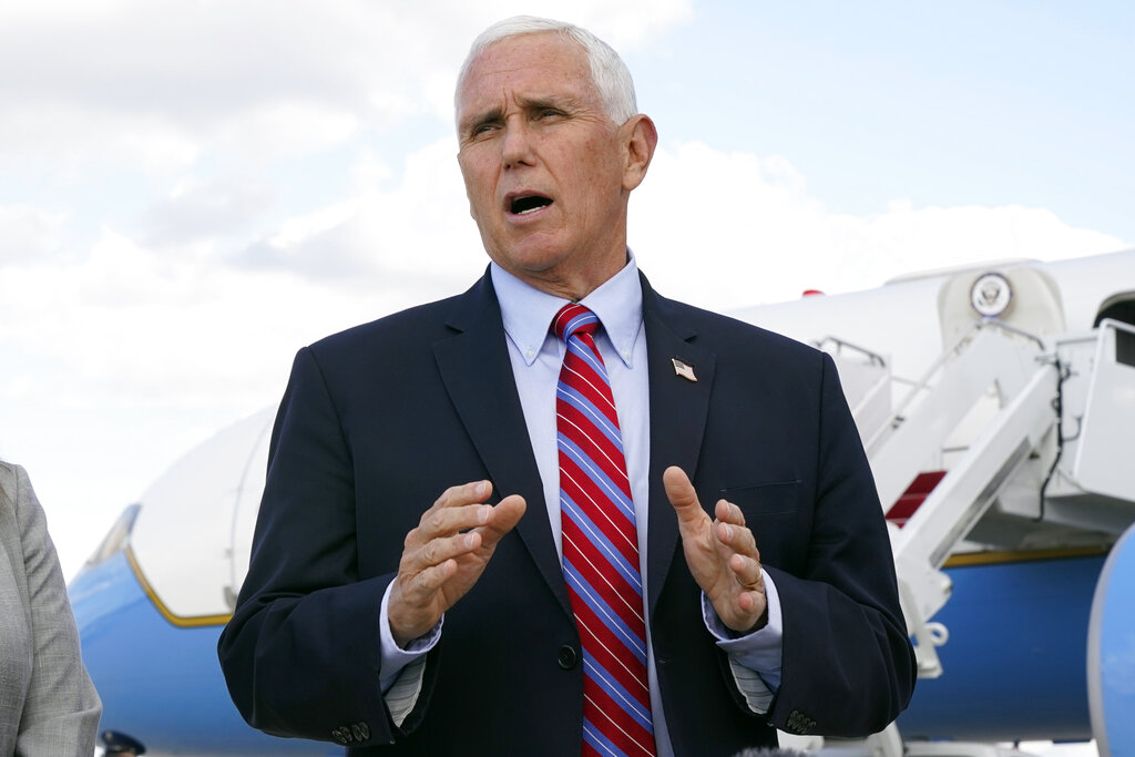 Vice President Mike Pence speaks to members of the media at Andrews Air Force Base in Maryland on October 5.