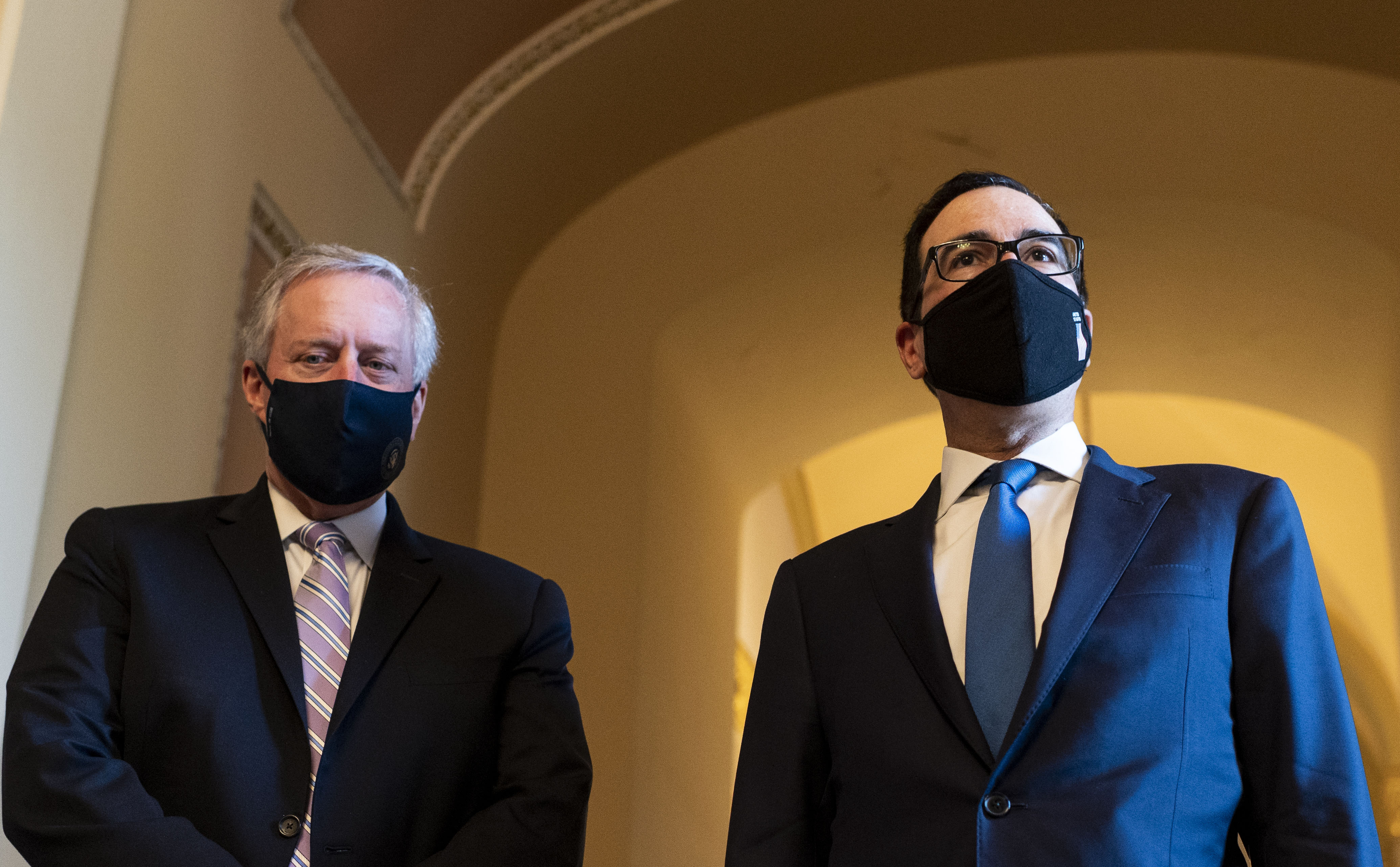 White House Chief of Staff Mark Meadows, left, and Treasury Secretary Steven Mnuchin speak to reporters as they leave a coronavirus aid meeting in Washington, DC, on July 23.