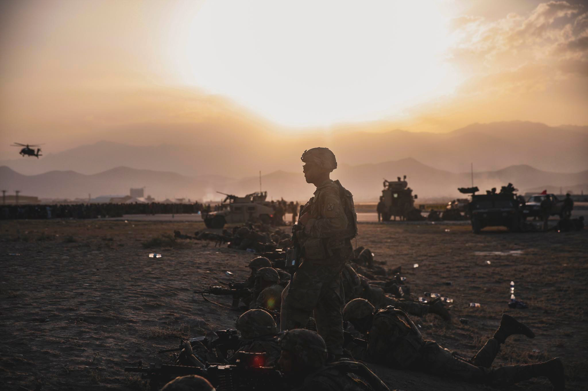 US Army soldiers assigned to the 10th Mountain Division stand security at Hamid Karzai International Airport in Kabul, Afghanistan, on August 16.