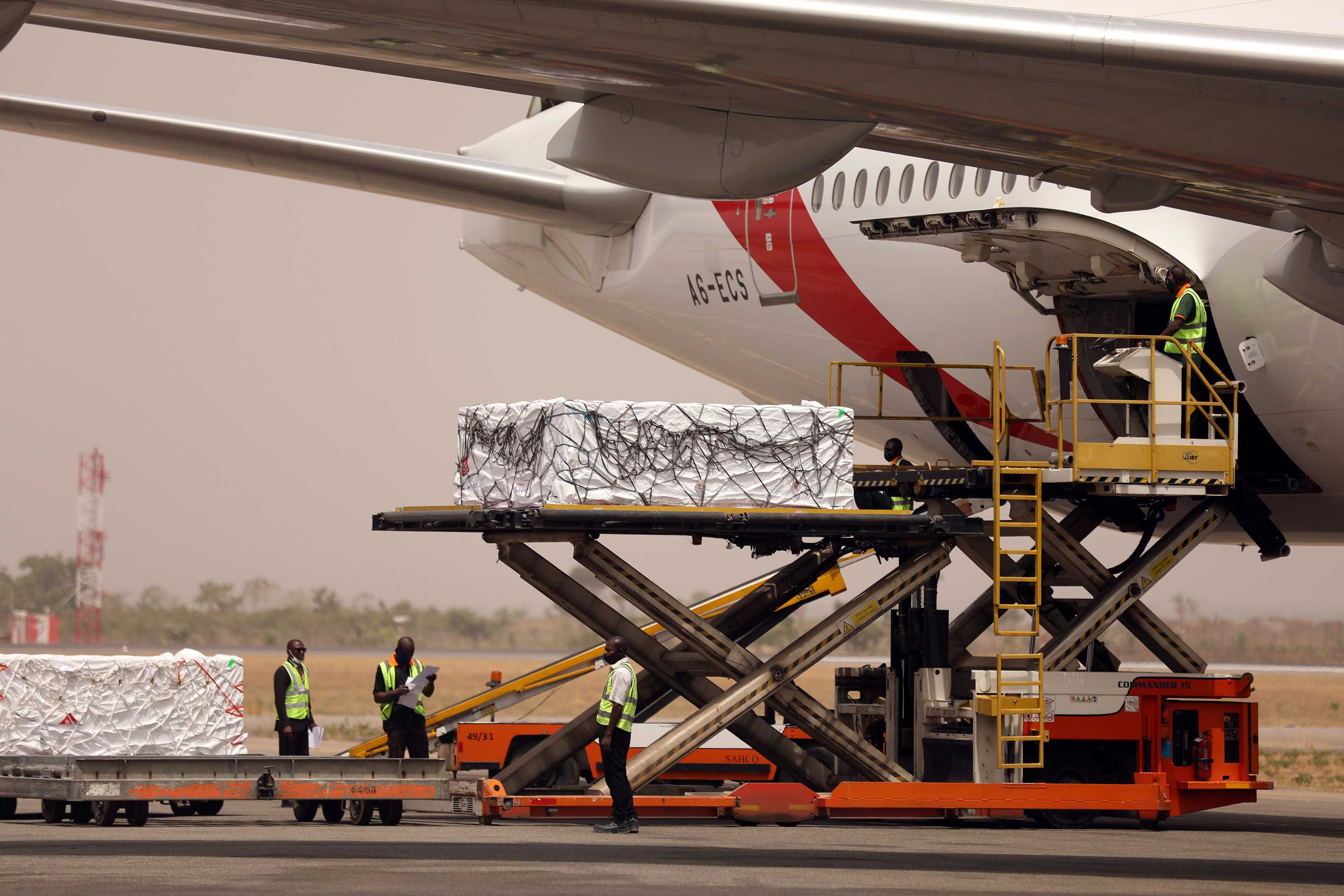 The first batch of Oxford-AstraZeneca Covid-19 vaccine doses are offloaded from a plane at  Nnamdi Azikiwe International Airport in Abuja, Nigeria, on March 2.