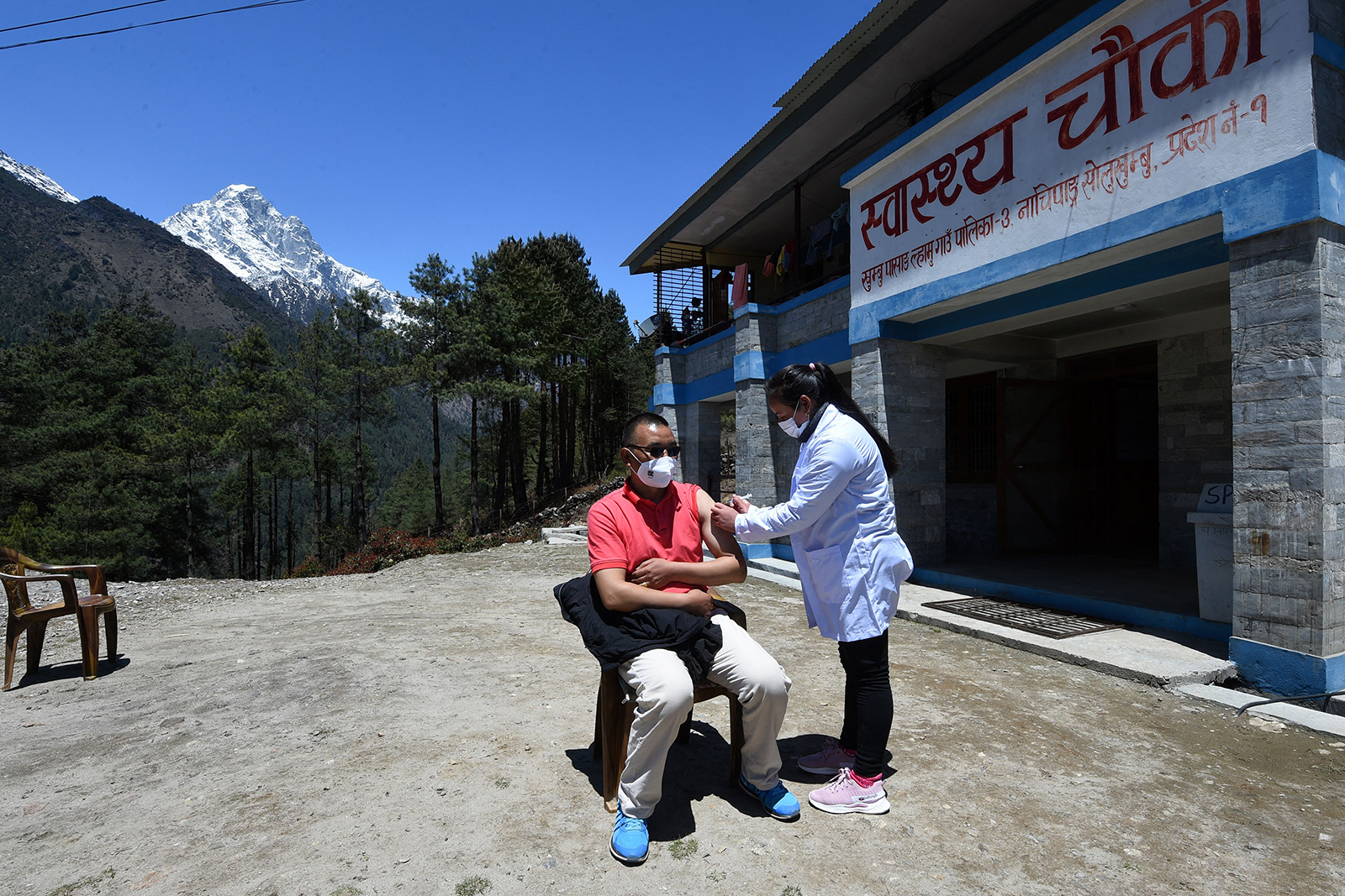 A health worker inoculates a man with the Covishield vaccine at a health post near Lukla on April 23 in Nepal.