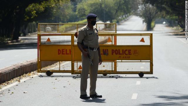 A policeman stands guard at a road checkpoint in New Delhi on March 25, as India's lockdown begins.