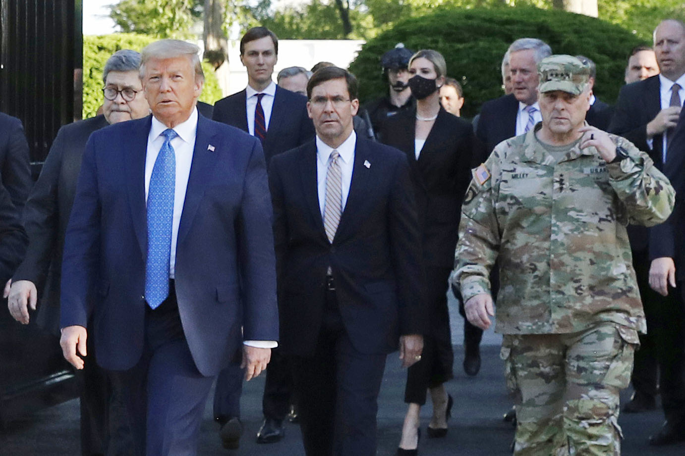 President Donald Trump departs the White House to take a photo outside St. John's Church in Washington on June 1. Walking behind Trump are Secretary of Defense Mark Esper, center, and Chairman of the Joint Chiefs of Staff Gen. Mark Milley, right.