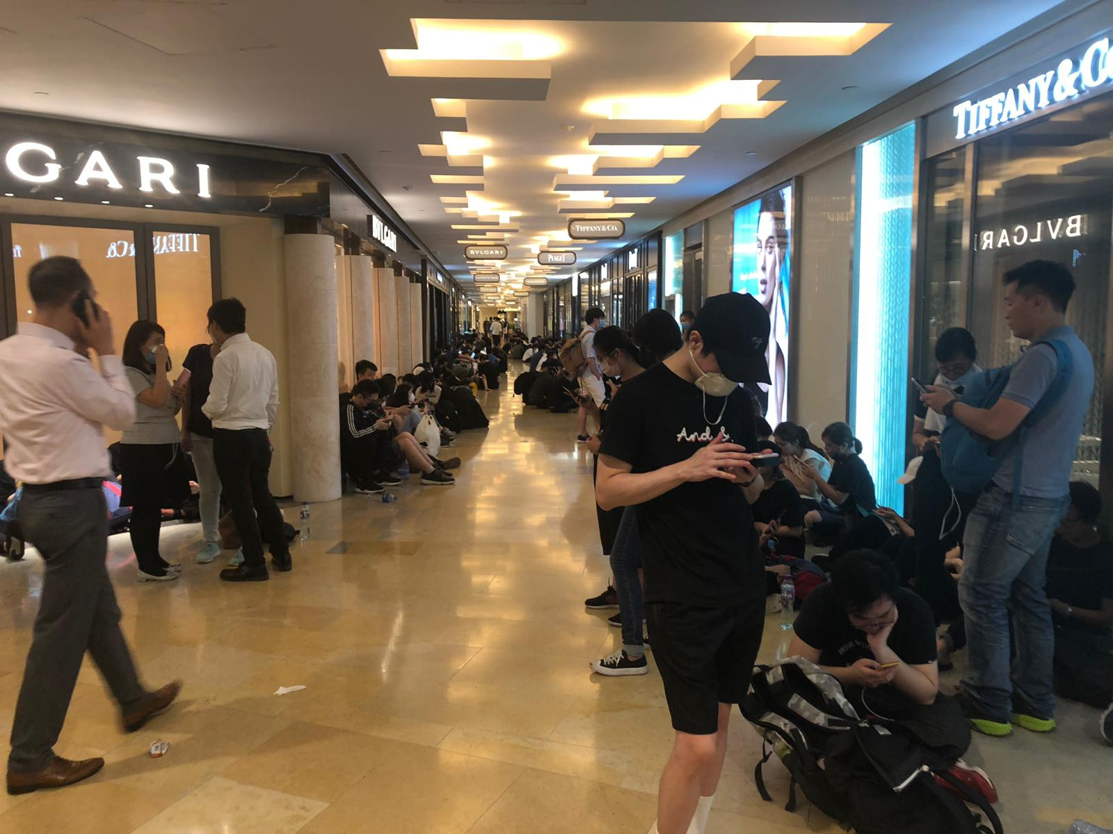 Protesters take shelter outside Tiffany & Co. at Pacific Place mall.