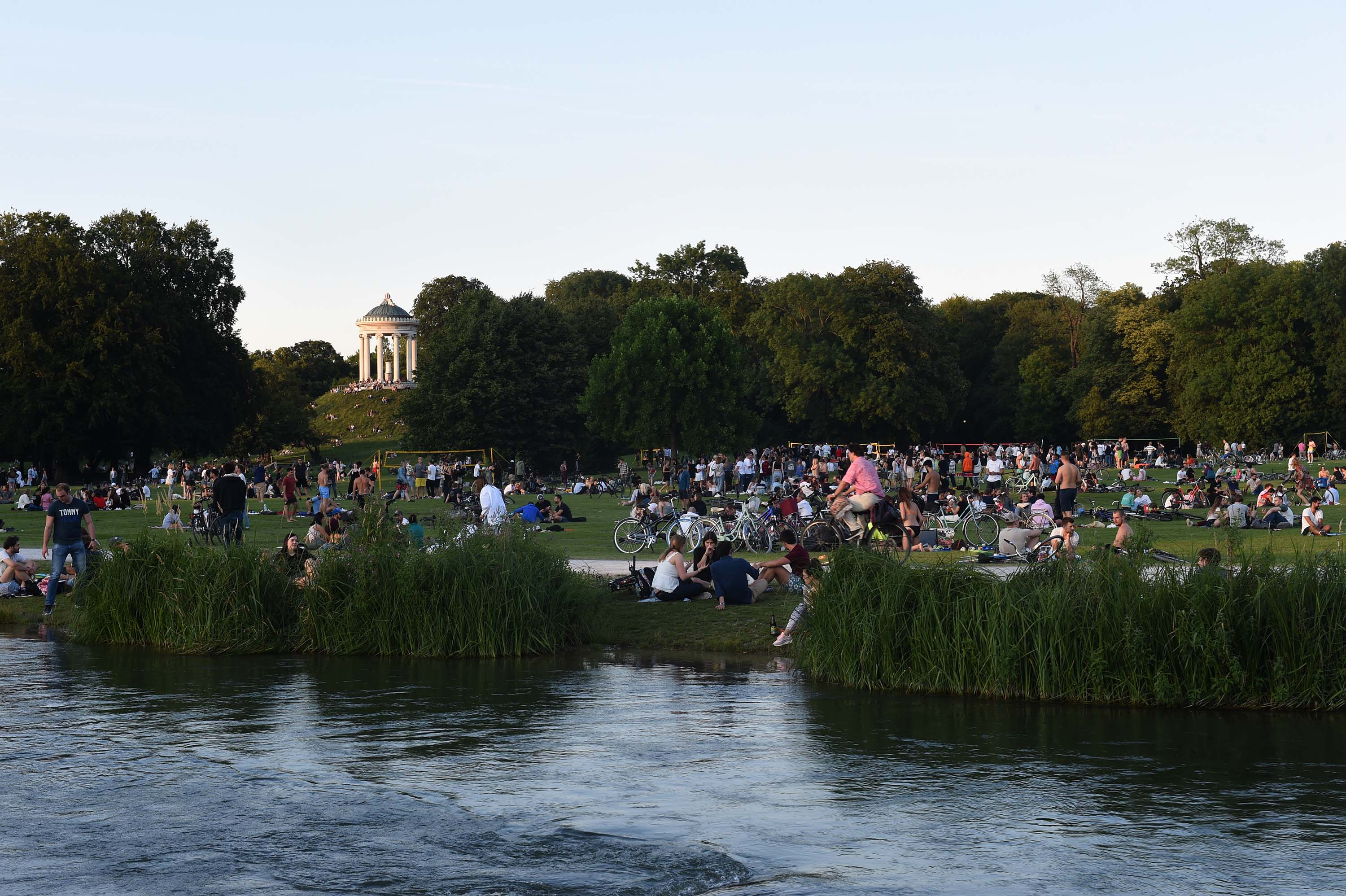 People enjoy a summer evening outdoors at the English Garden in Munich, Germany, on July 14.