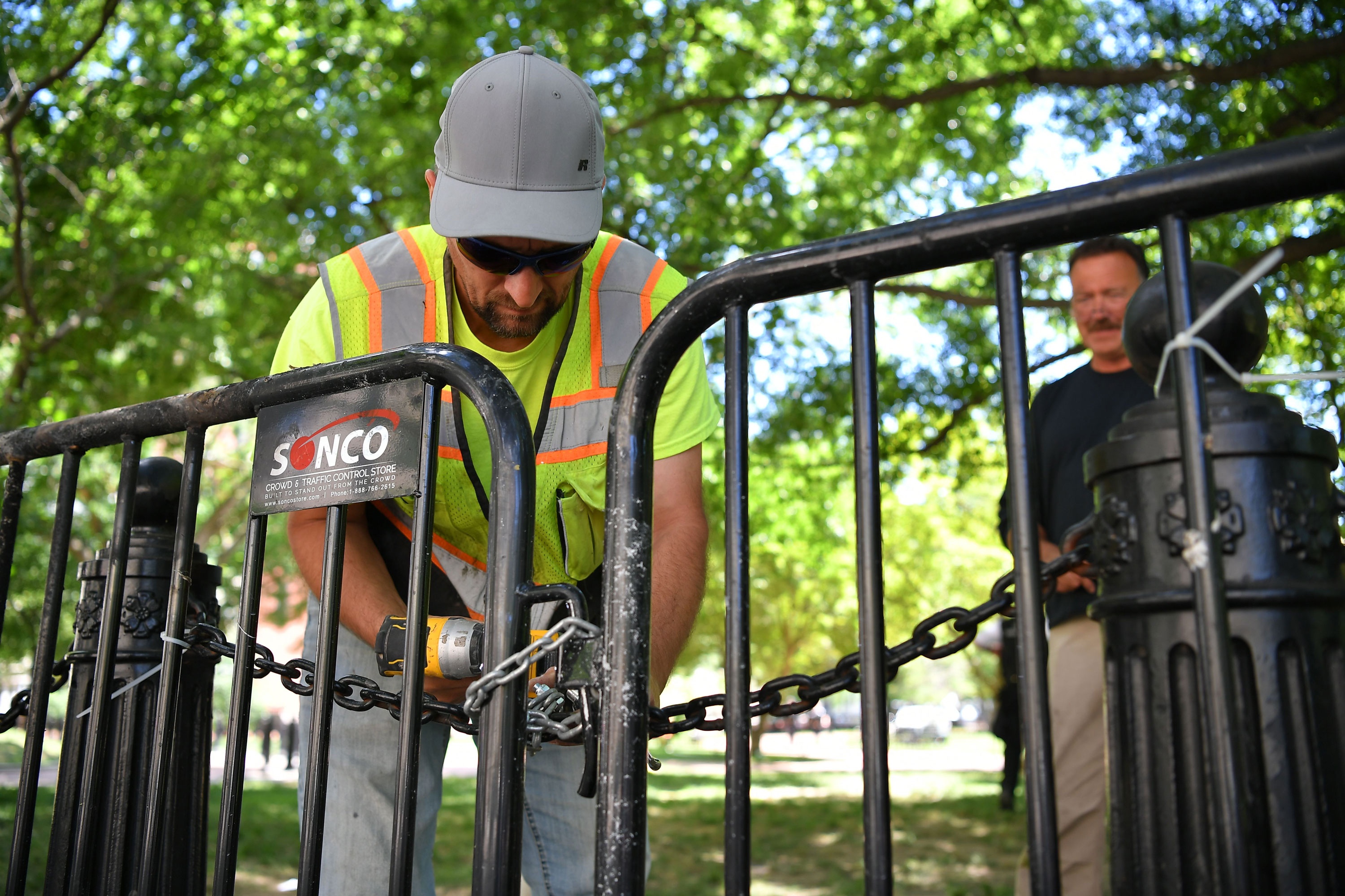 A worker reinforces fencing around Lafayette Square near the White House in Washington on June 1.