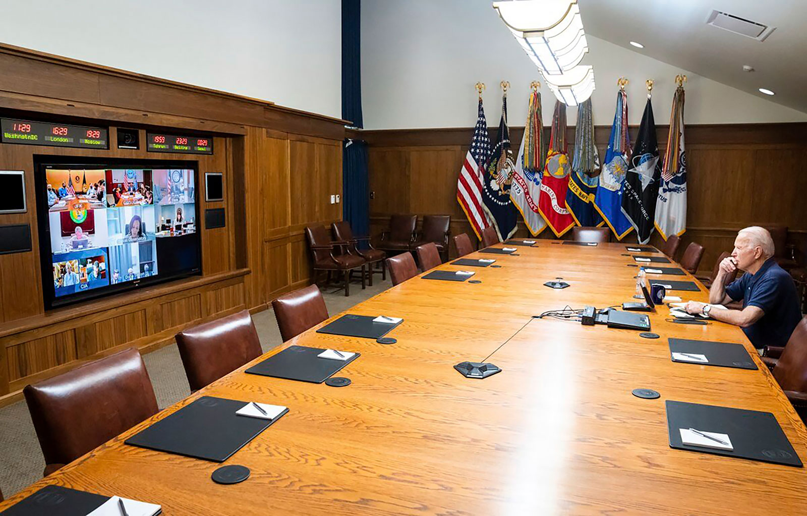 President Joe Biden meets virtually with his national security team for a briefing on Afghanistan at Camp David on Sunday, August 15.
