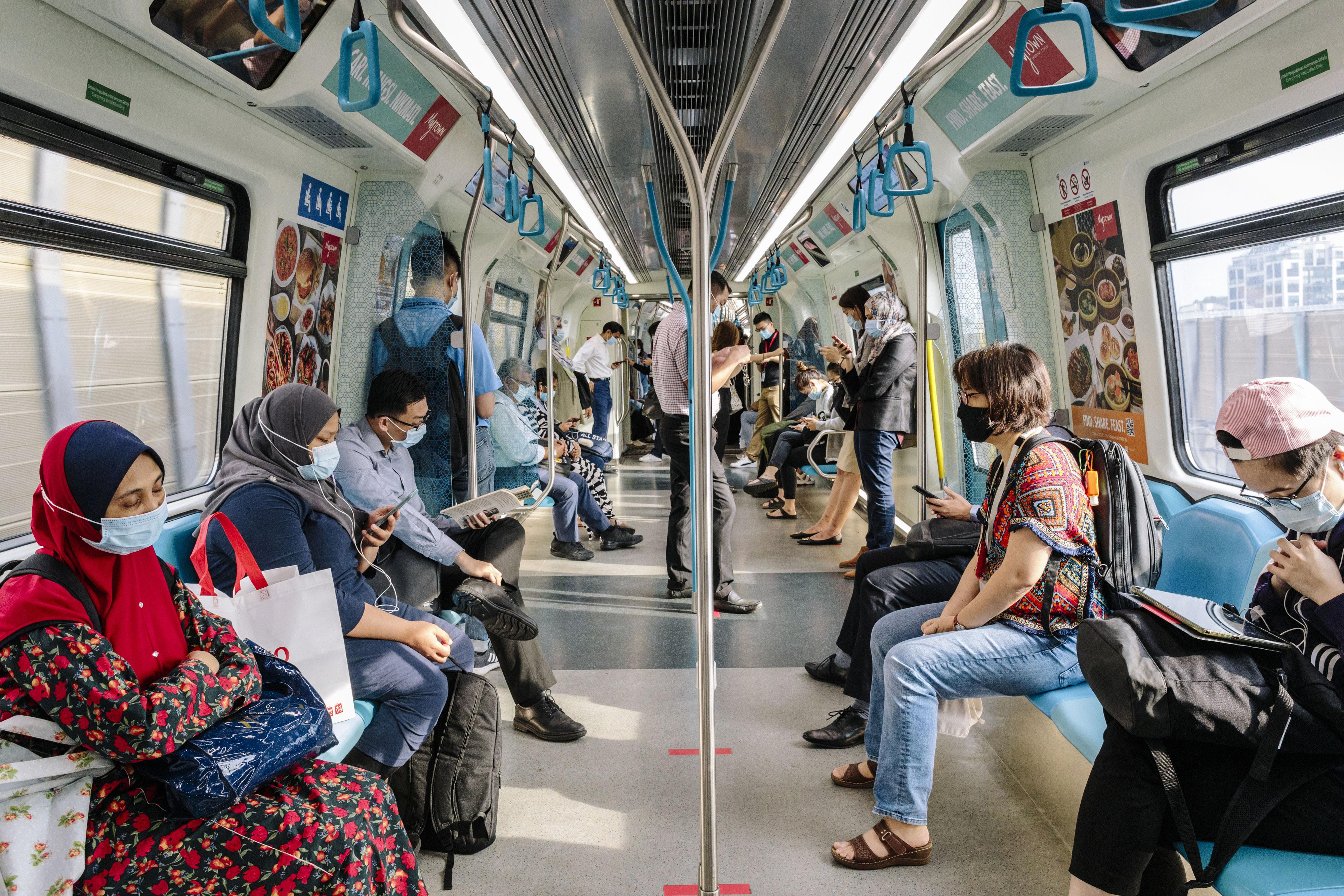 People ride a train in Kuala Lumpur, Malaysia, on September 28.