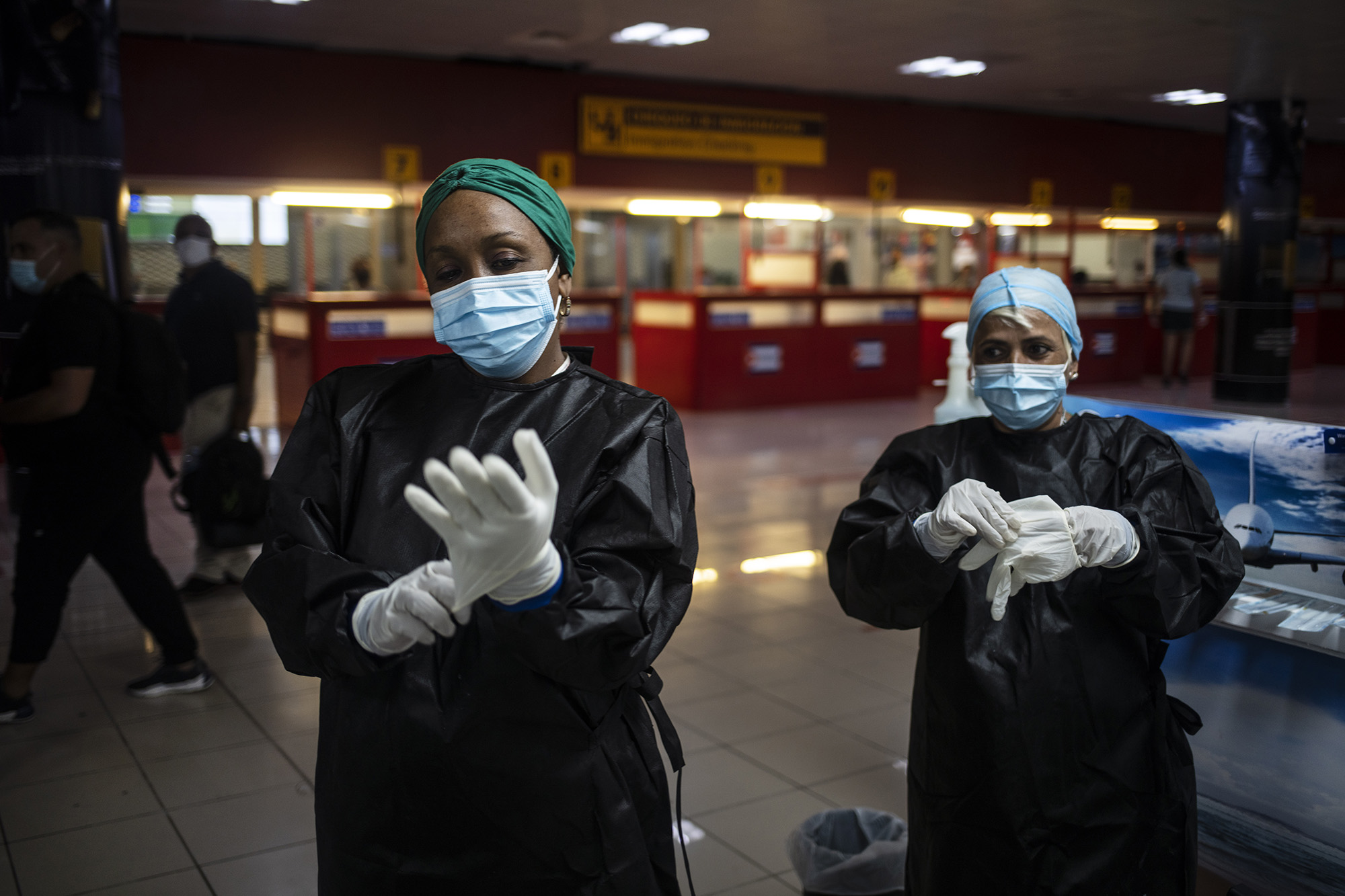 Health workers prepare to administer Covid-19 tests for passengers arriving from Mexico at the Jose Marti International Airport in Havana, Cuba, on November 15, 2020.