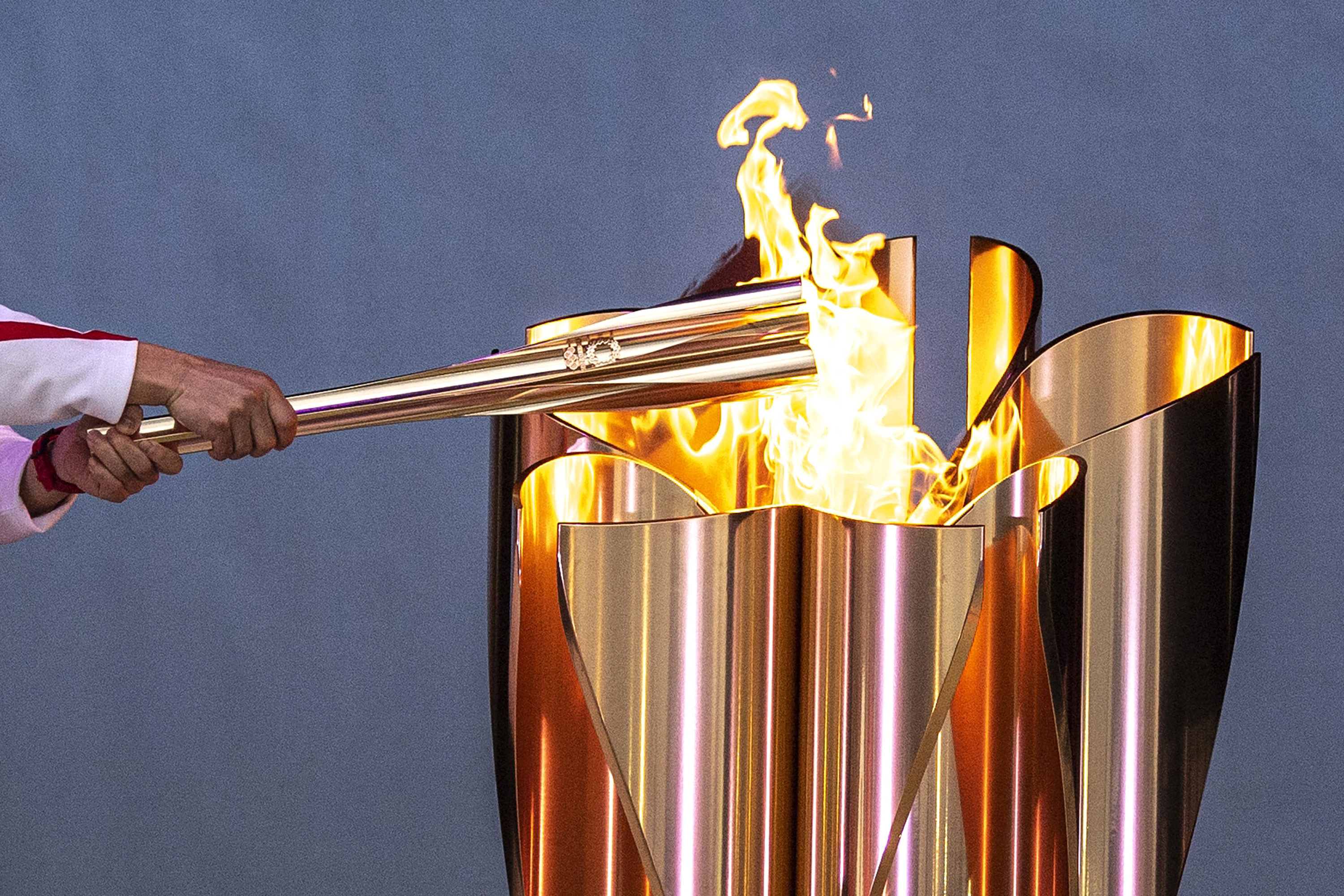 The celebration cauldron is lit during the Tokyo 2020 Olympic torch relay in Minamisoma, Japan, on March 25.