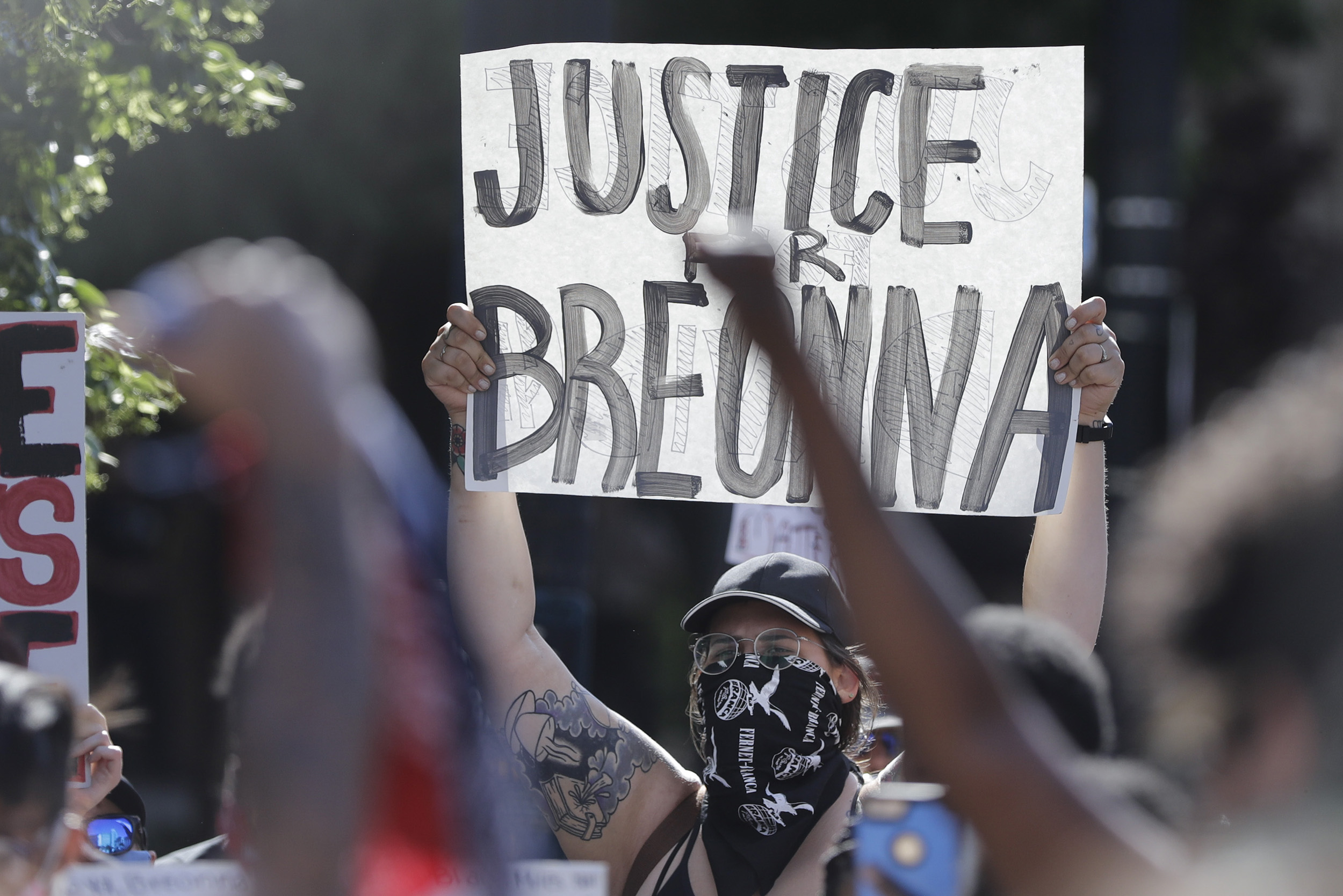 A protester holds a sign during a protest over the death of Breonna Taylor, on Monday, June 1, in Louisville, Kentucky.