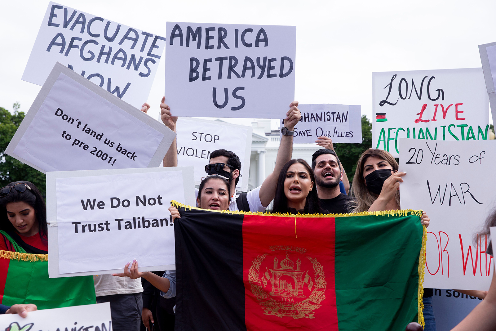 People protest in support of Afghanistan and against the Taliban take over of the country, at Lafayette Square across the street from the White House in Washington DC on August 15.