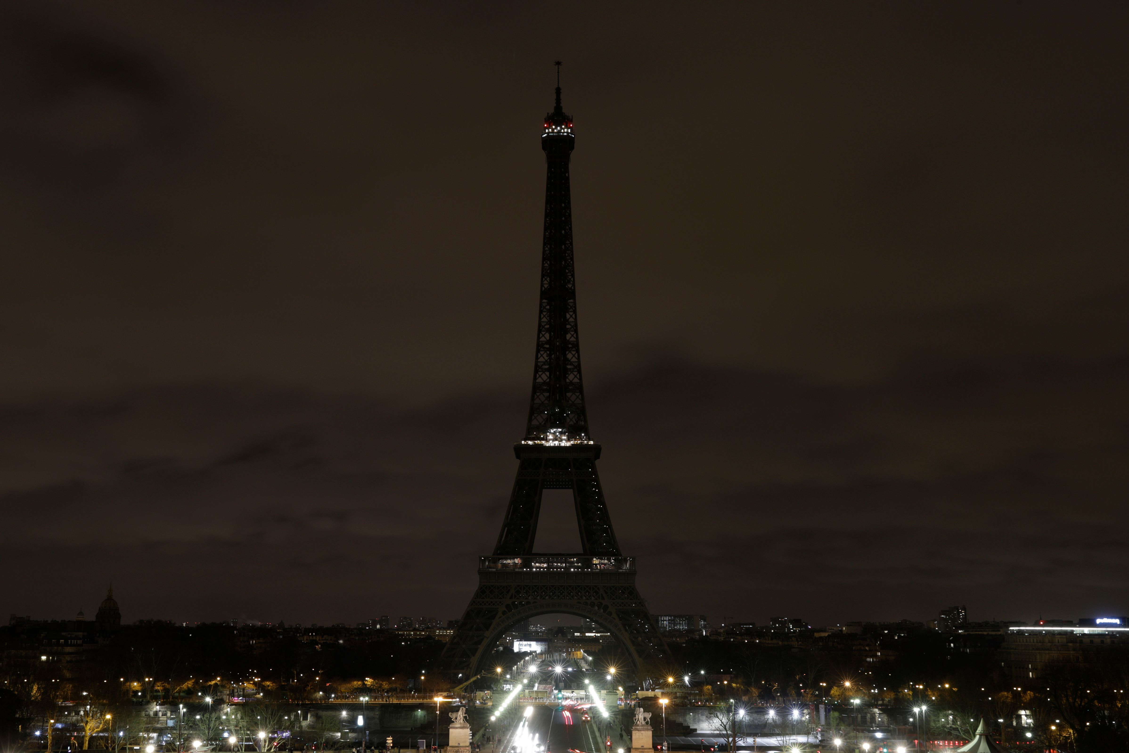 The Eiffel Tower in Paris goes dark on Friday evening