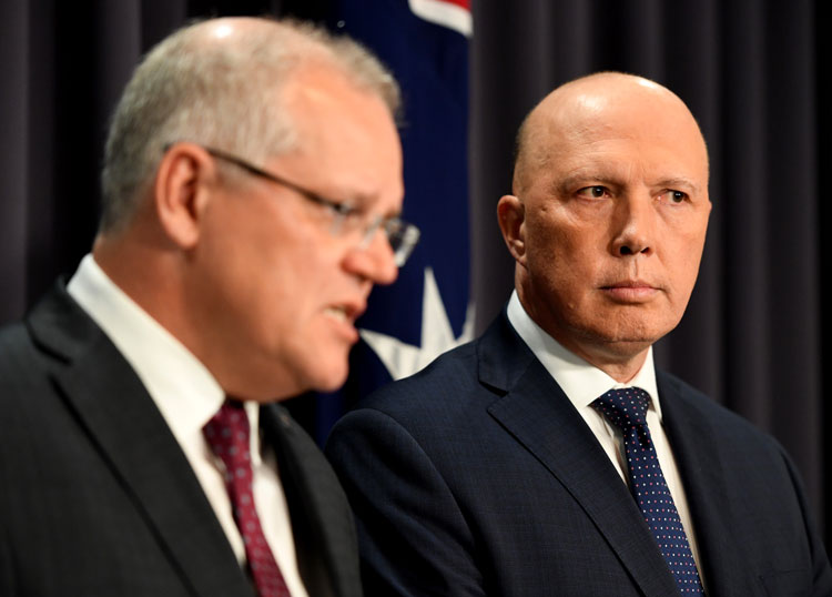 Prime Minister Scott Morrison, left, and Home Affairs Minister Peter Dutton, right, hold a news conference at Parliament House on December 02, 2019 in Canberra, Australia.