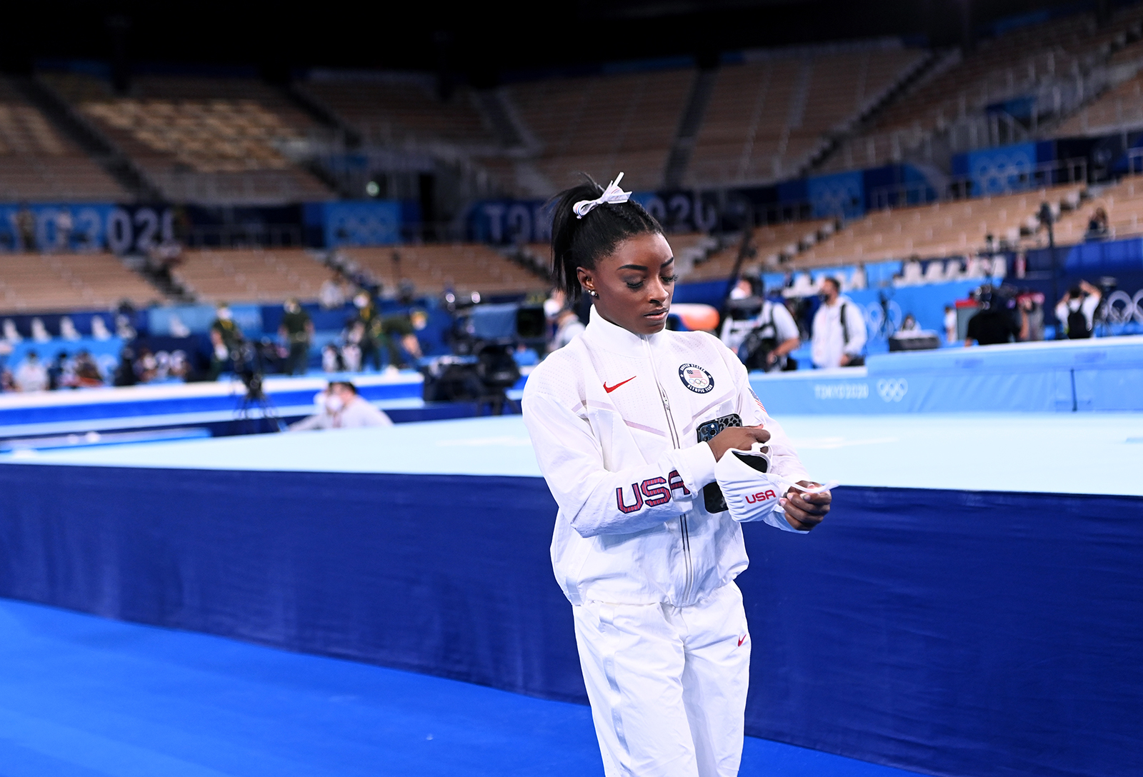 Simone Biles walks alone after the women's team final at the 2020 Tokyo Olympics.