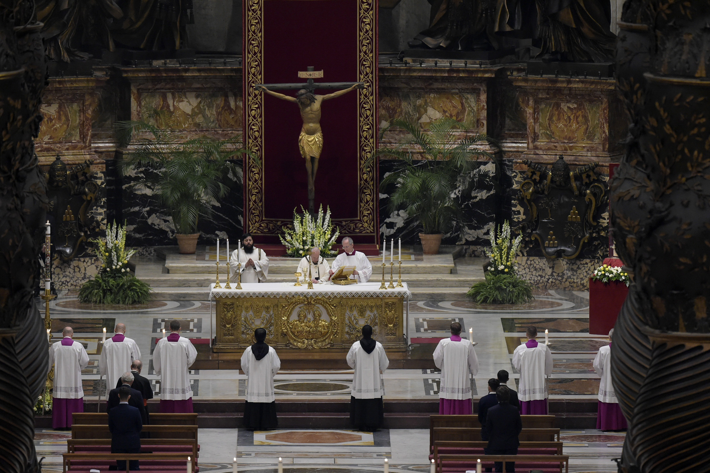 Pope Francis presides over an Easter vigil in St. Peter's Basilica in the Vatican on April 11.