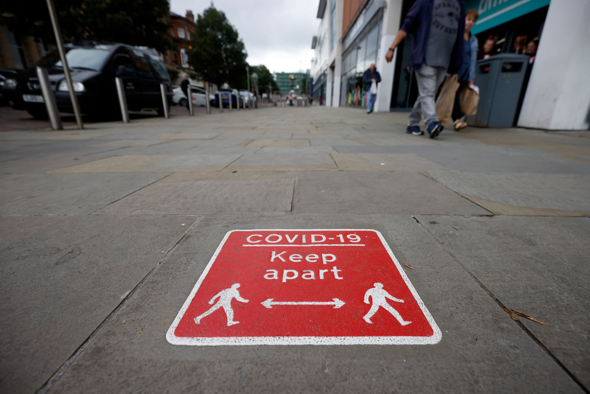 Social distancing signs are seen in Blackburn town center on July 17 in Blackburn, England.