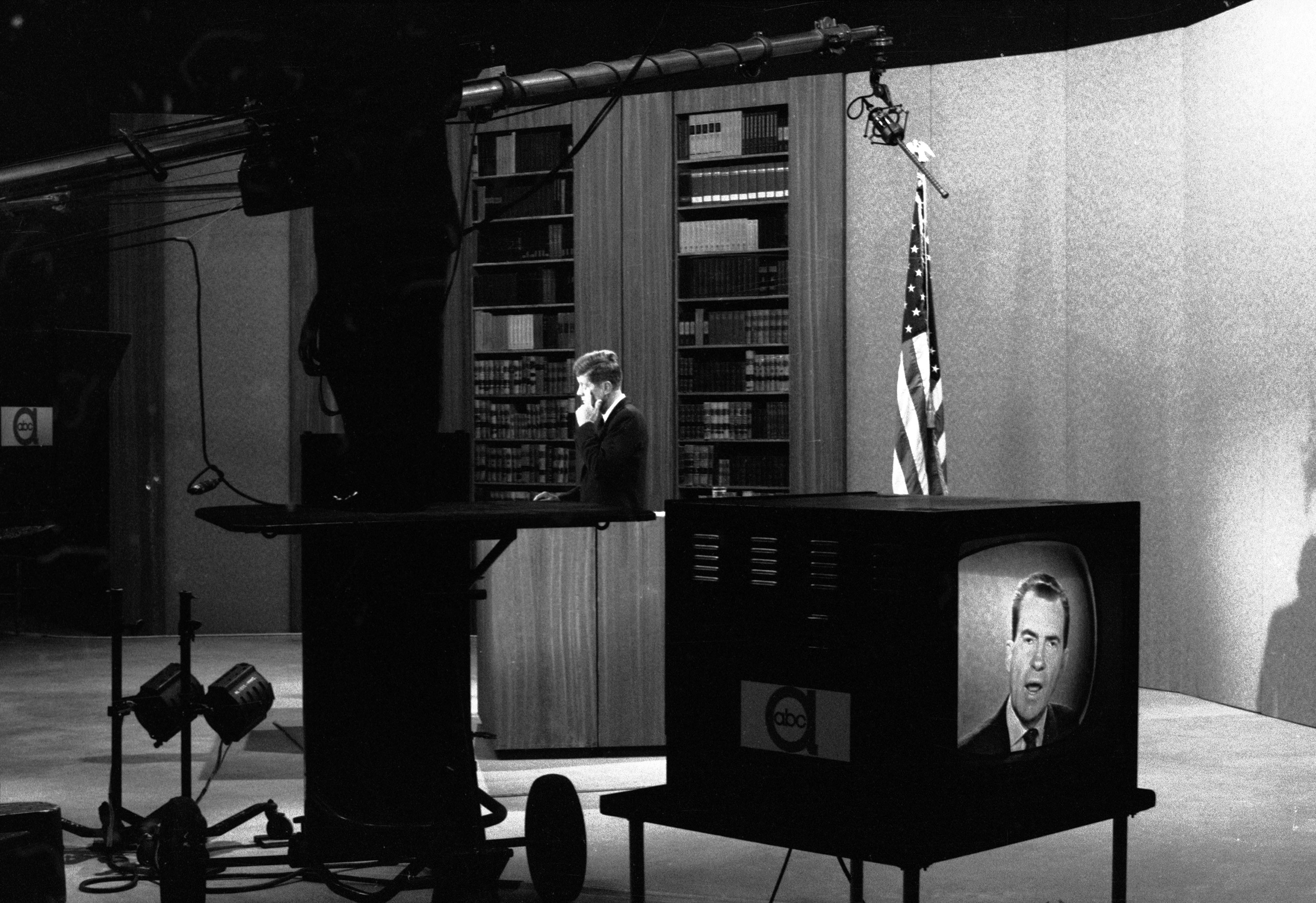 In a studio at ABC television in New York, Sen. John F. Kennedy listens to Vice President Richard M. Nixon who was in a studio in Los Angles on October 13, 1960.