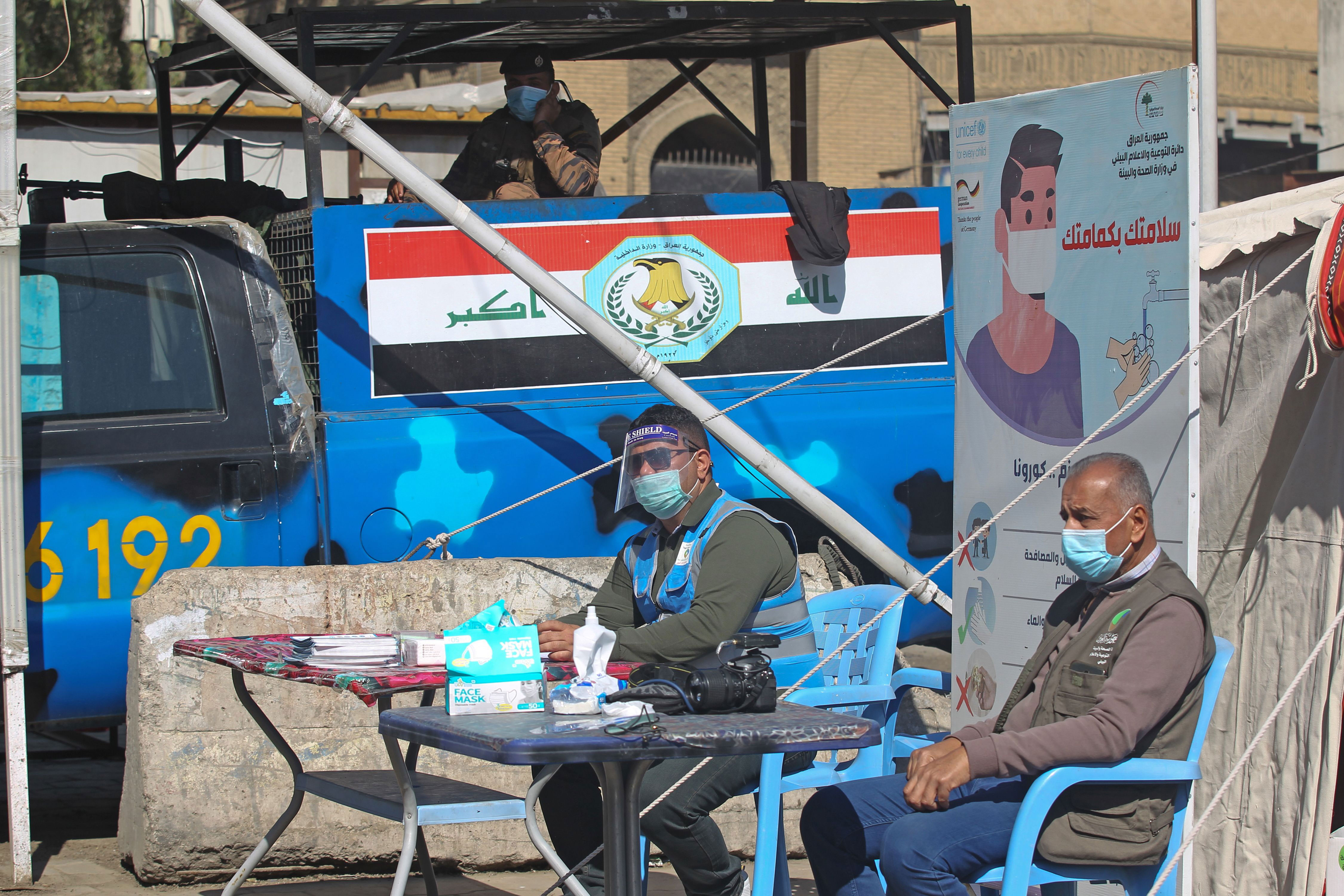 Iraqi health personnel work at a mobile Covid-19 testing unit at Baghdad's Shorja market on February 22.