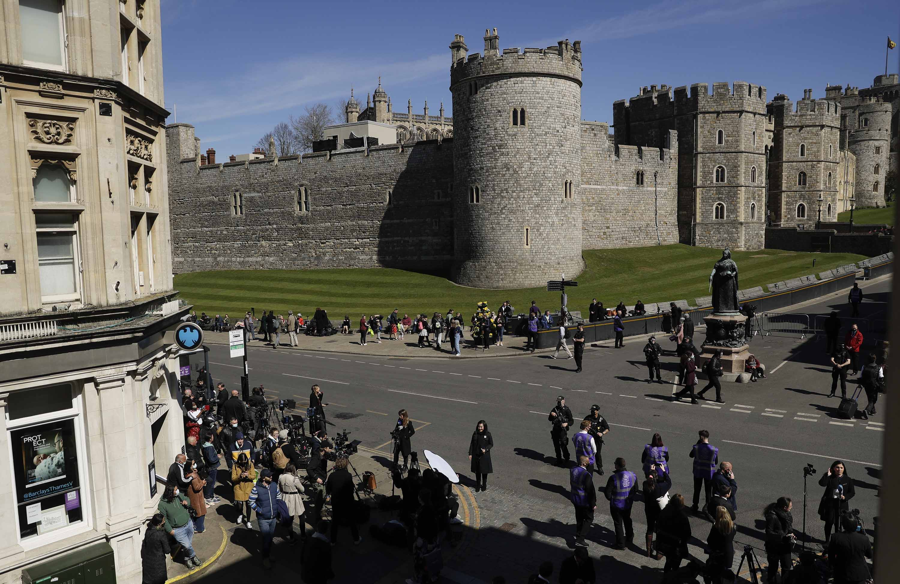 People gather ahead of the funeral of Britain's Prince Philip in Windsor, England, on Saturday April 17.