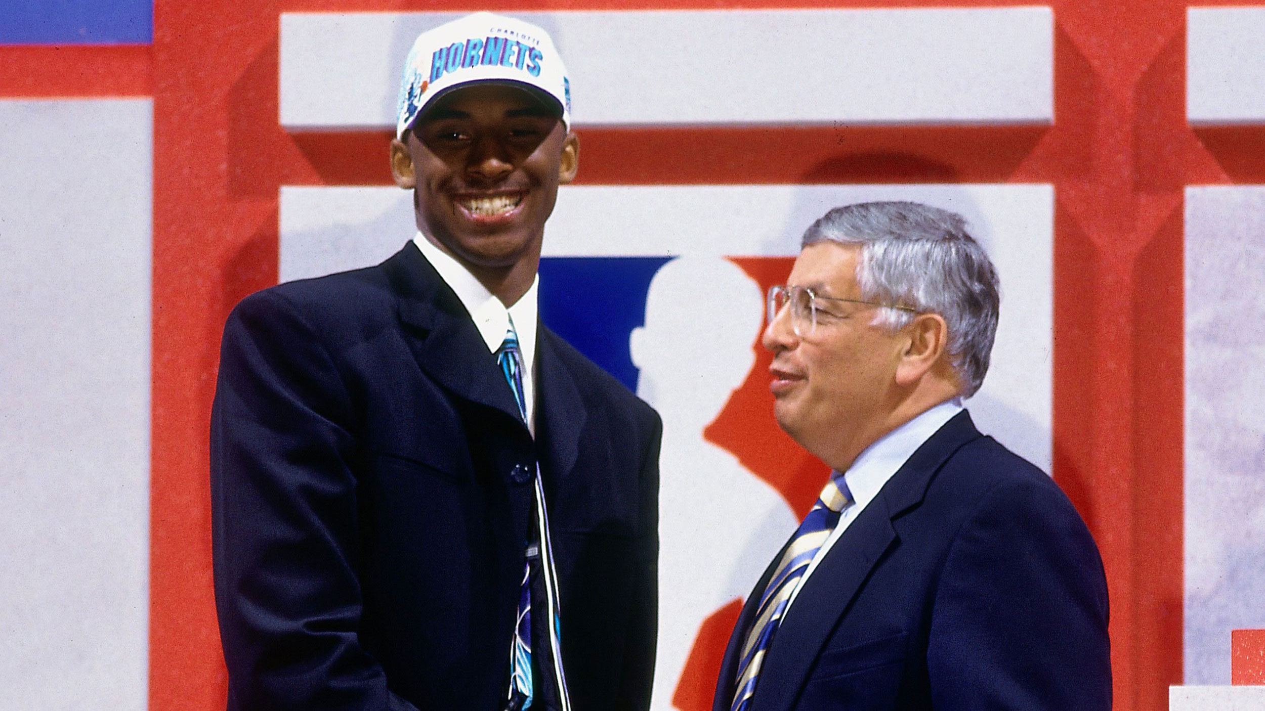 Kobe Bryant poses with NBA Commissioner David Stern after being selected in the first round of the 1996 NBA Draft by the Charlotte Hornets.