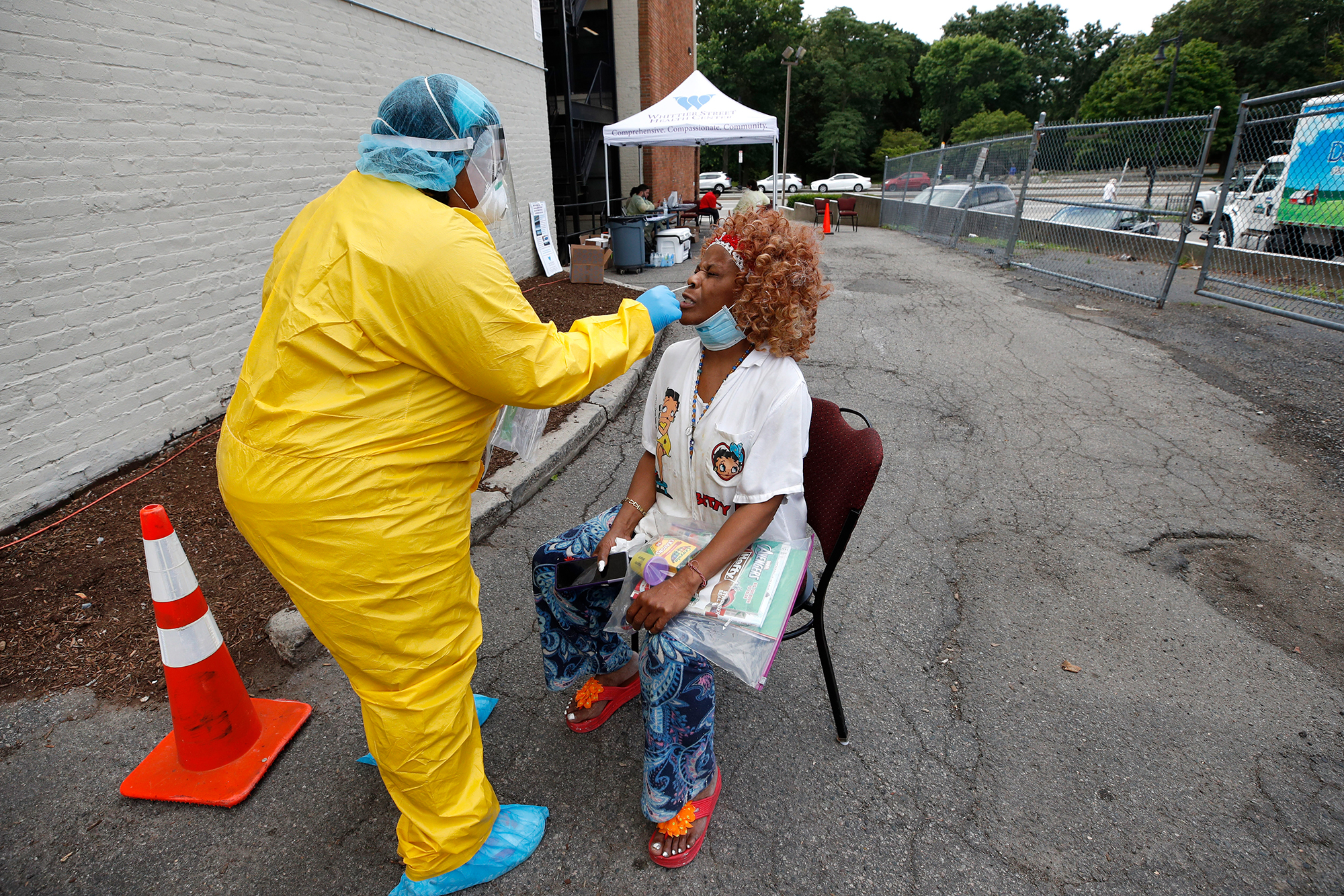 A COVID-19 test is administered at the Whittier Street Health Center's mobile test site on. Wednesday, July 15, 2020, in Boston, Mass.