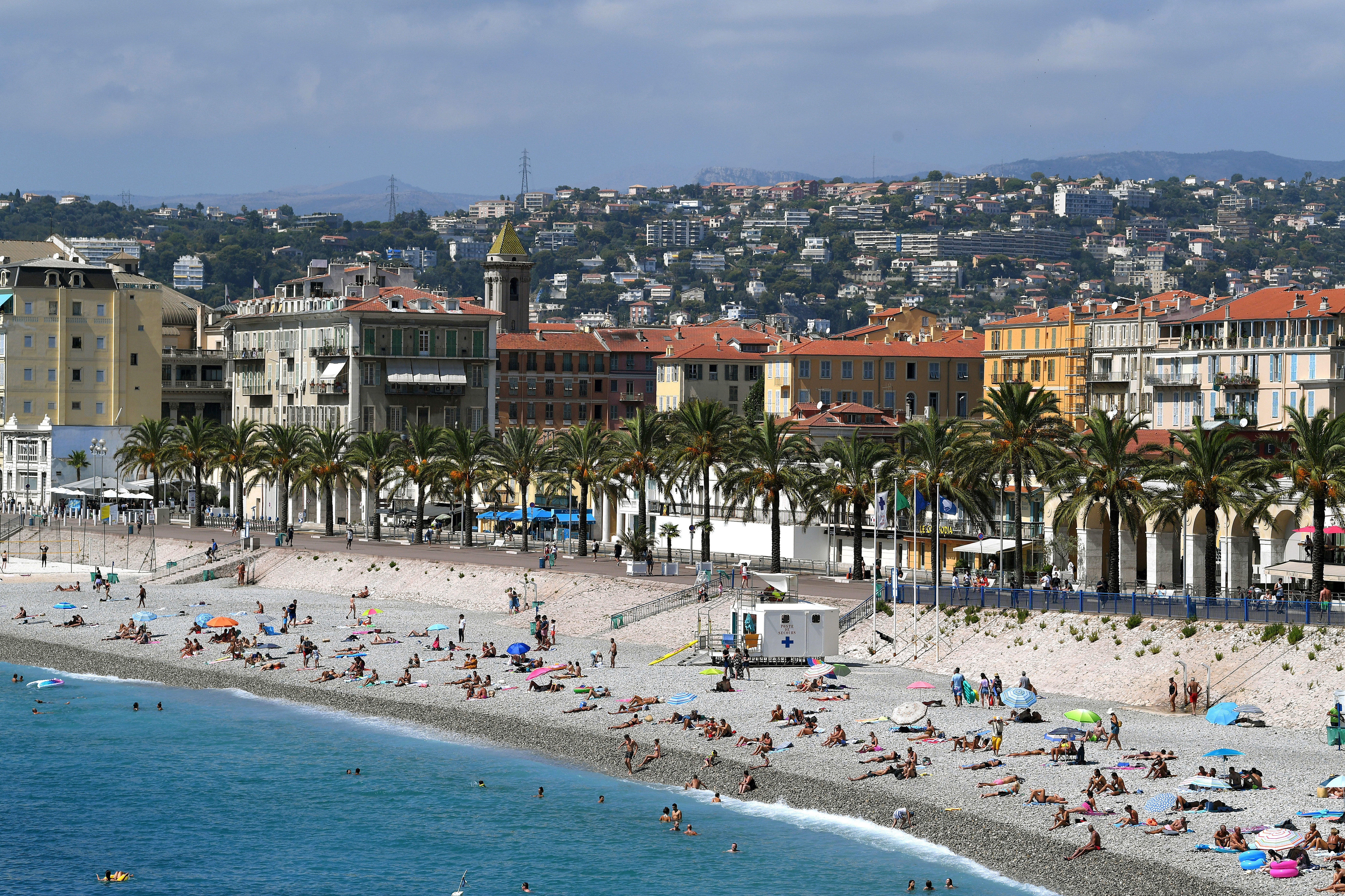 People visit a beach in Nice, France, on August 27.