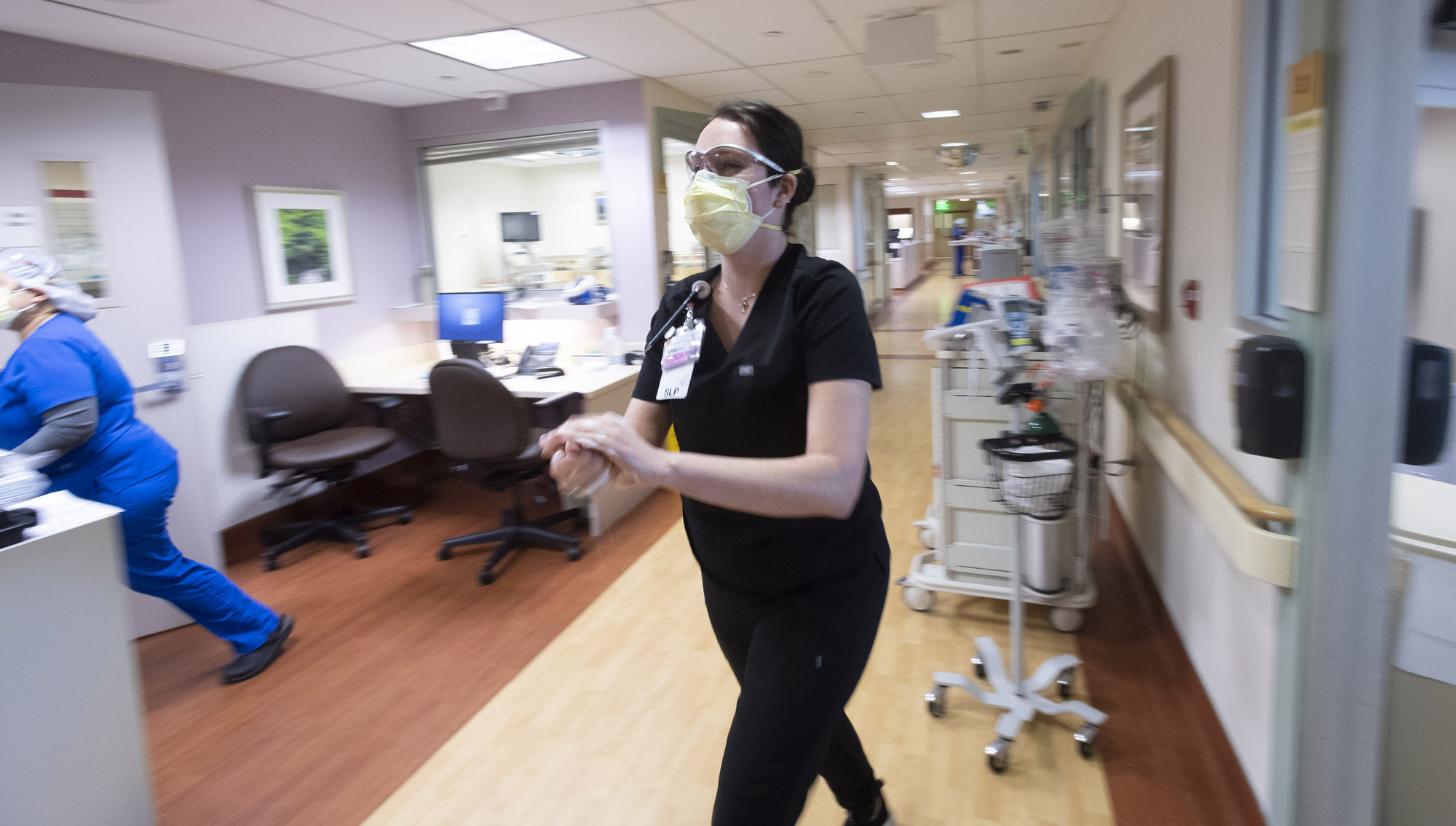 A staff member sanitizes her hands in the Critical Care Unit at St. Jude Medical Center in Fullerton, CA on Tuesday, December 1.