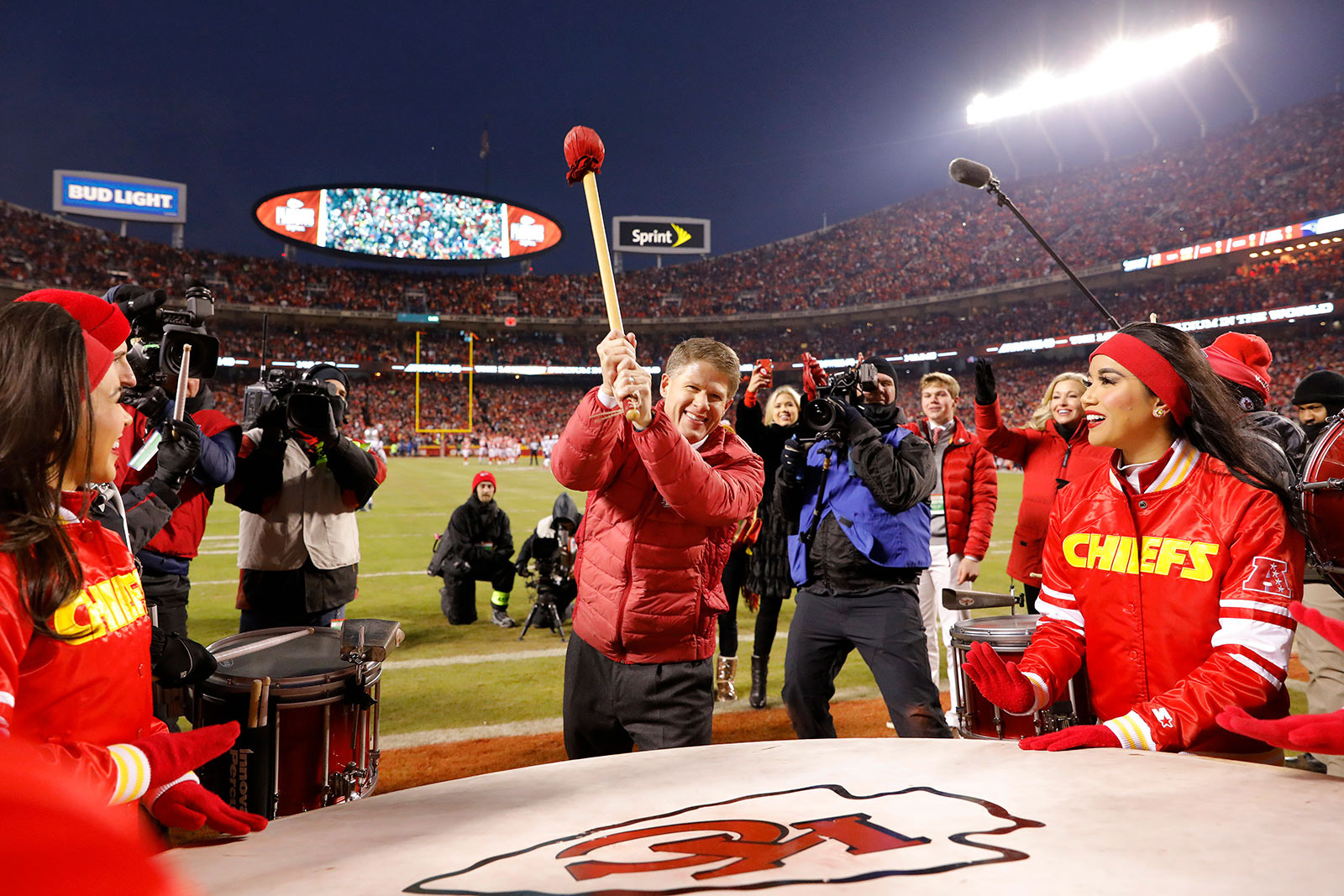 Kansas City Chiefs owner Clark Hunt bangs the drum before the AFC Championship Game against the New England Patriots on January 20, 2019.
