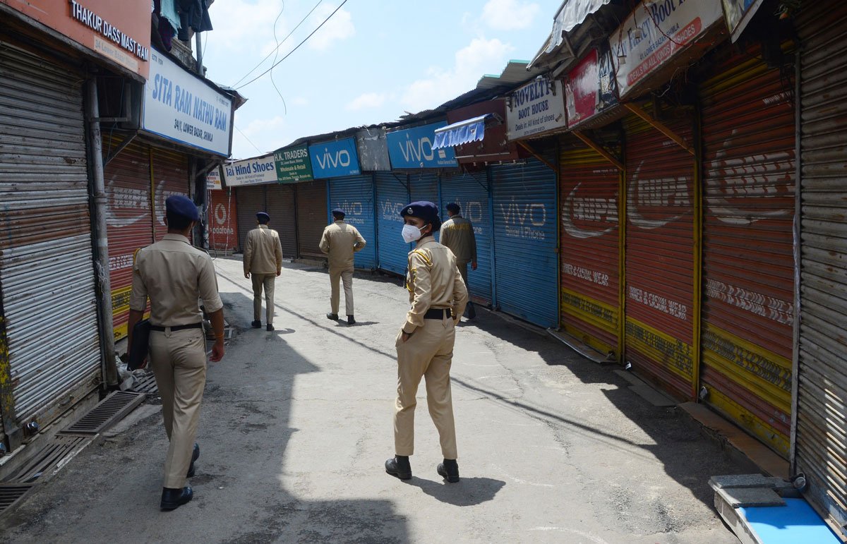 Police personnel patrol the streets of Lower Bazaar during a curfew imposed to curb the spread of Covid-19, on May 8 in Shimla, India.