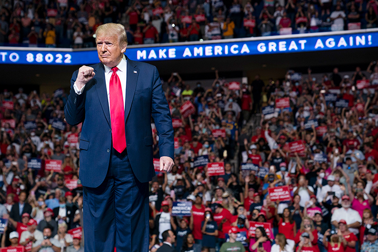 President Donald Trump arrives on stage to speak at a campaign rally at the BOK Center, Saturday, June 20, in Tulsa, Oklahoma.