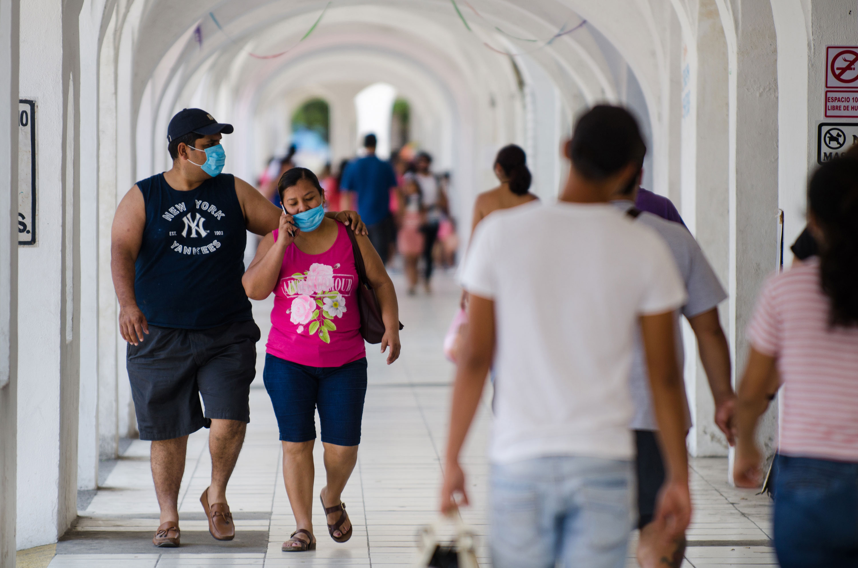 People walk around the center of Manzanillo, Mexico, on May 2.