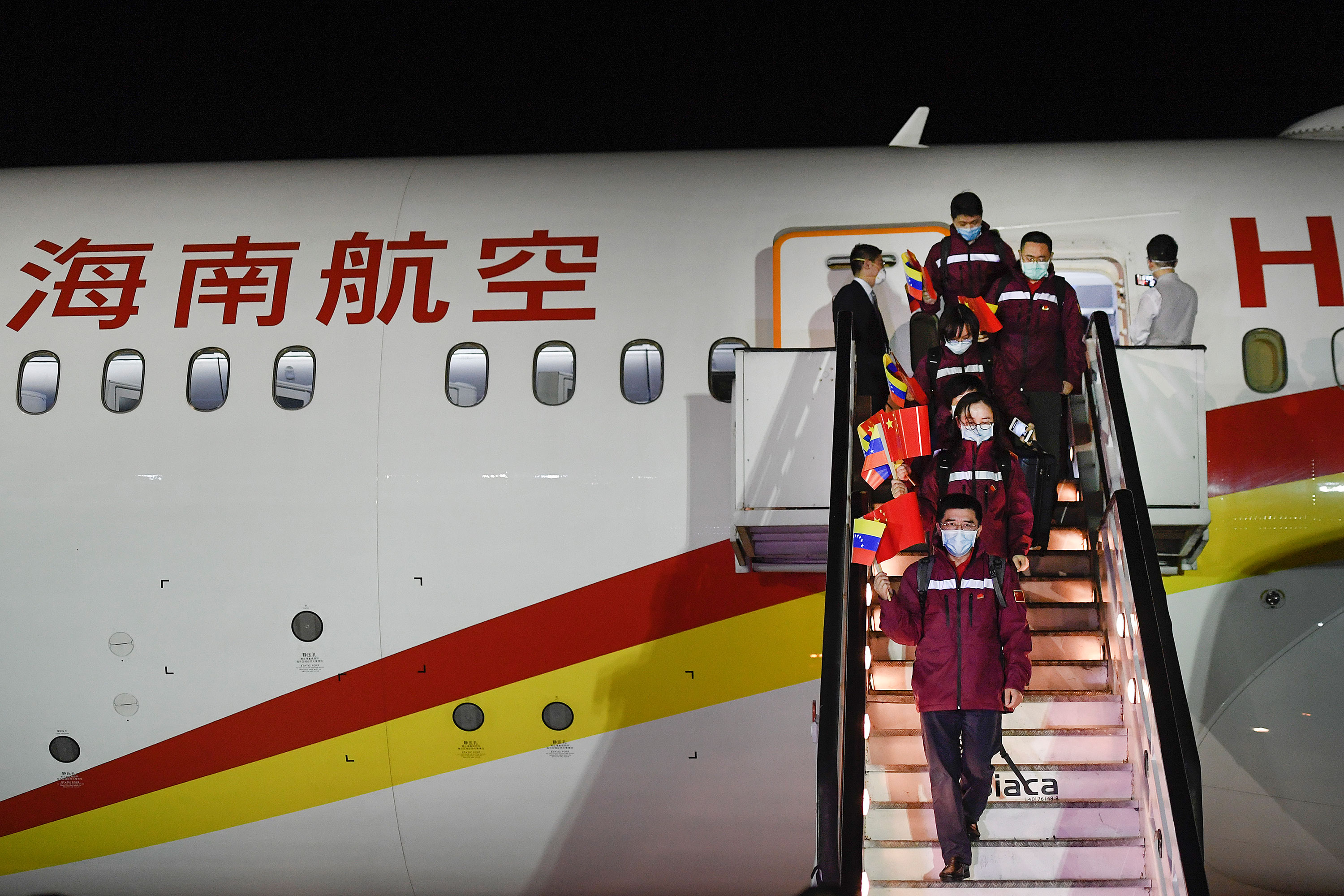 Medical specialists from China arrive at the Simon Bolivar International Airport in La Guaira, Venezuela, on March 30.