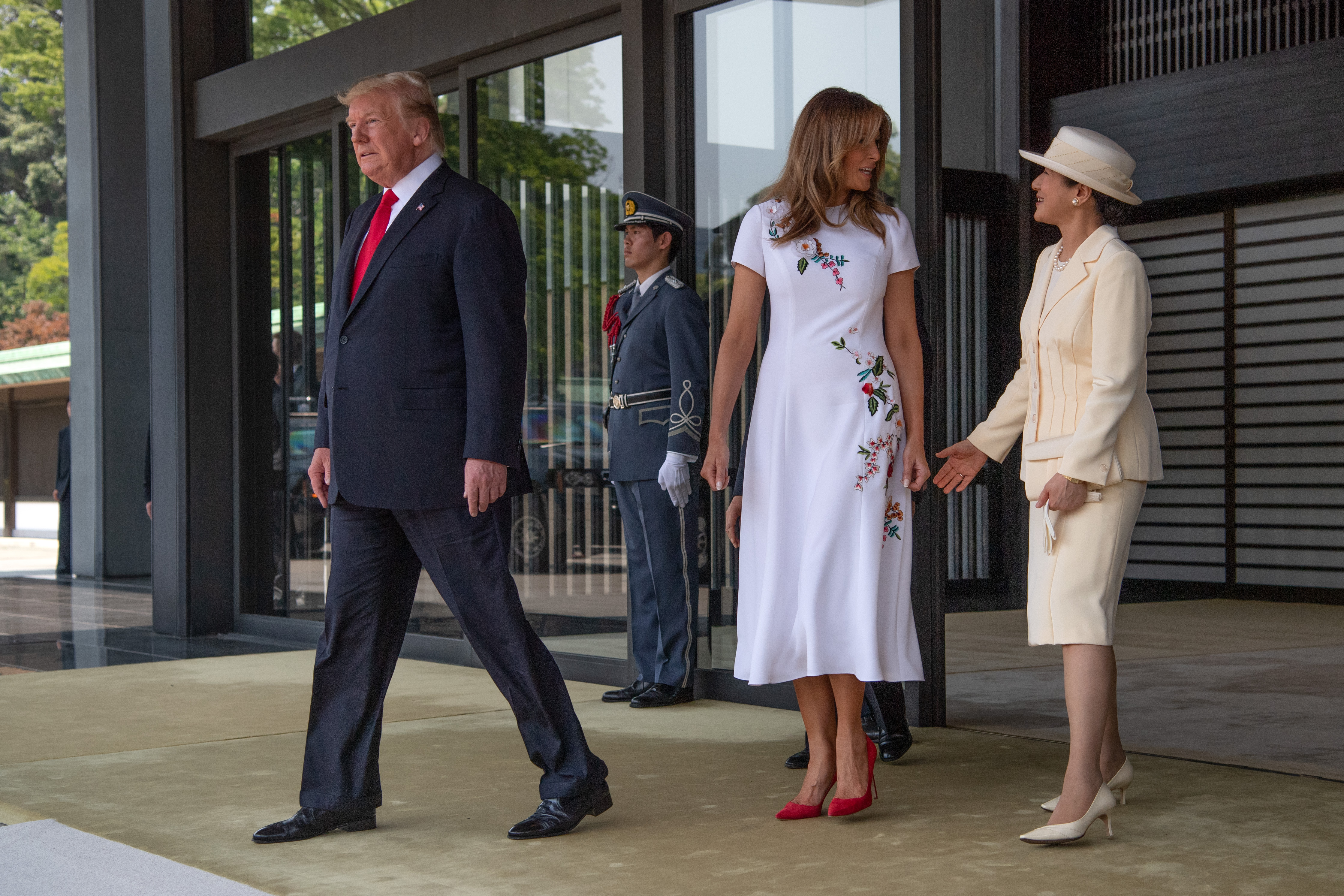 US President Donald Trump and first lady Melania Trump leave after meeting Emperor Naruhito (obscured) and empress Masako at the Imperial Palace on May 27, 2019, in Tokyo, Japan.