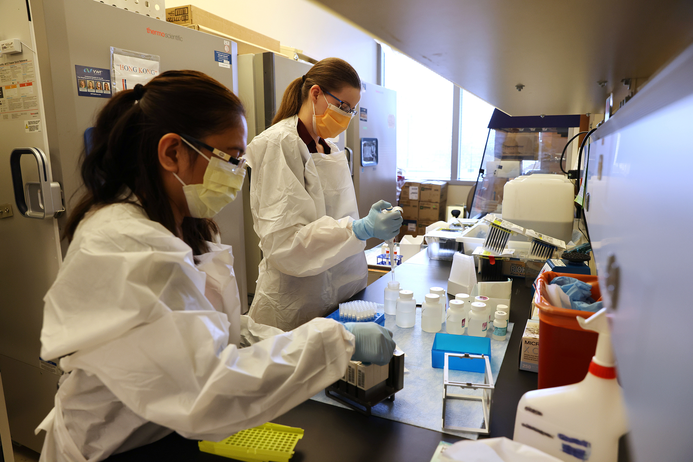 Medical lab scientists work on samples collected in the Novavax phase 3 clinical vaccine trial at Harborview Medical Center in Seattle, Washington, on February 12.