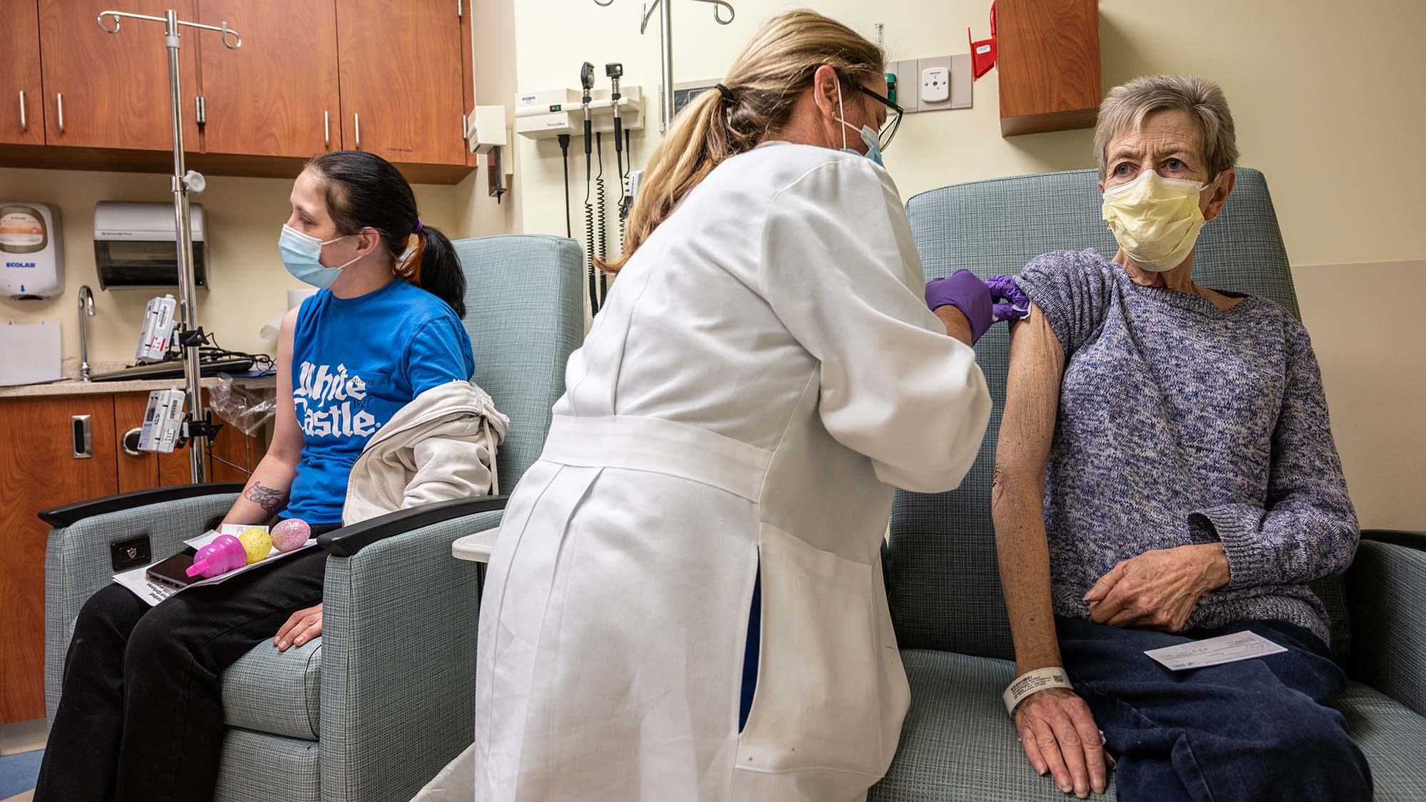A cancer patient receives her COVID-19 vaccine in an oncology unit at the James Graham Brown Cancer Center on April 2, in Louisville, Kentucky.