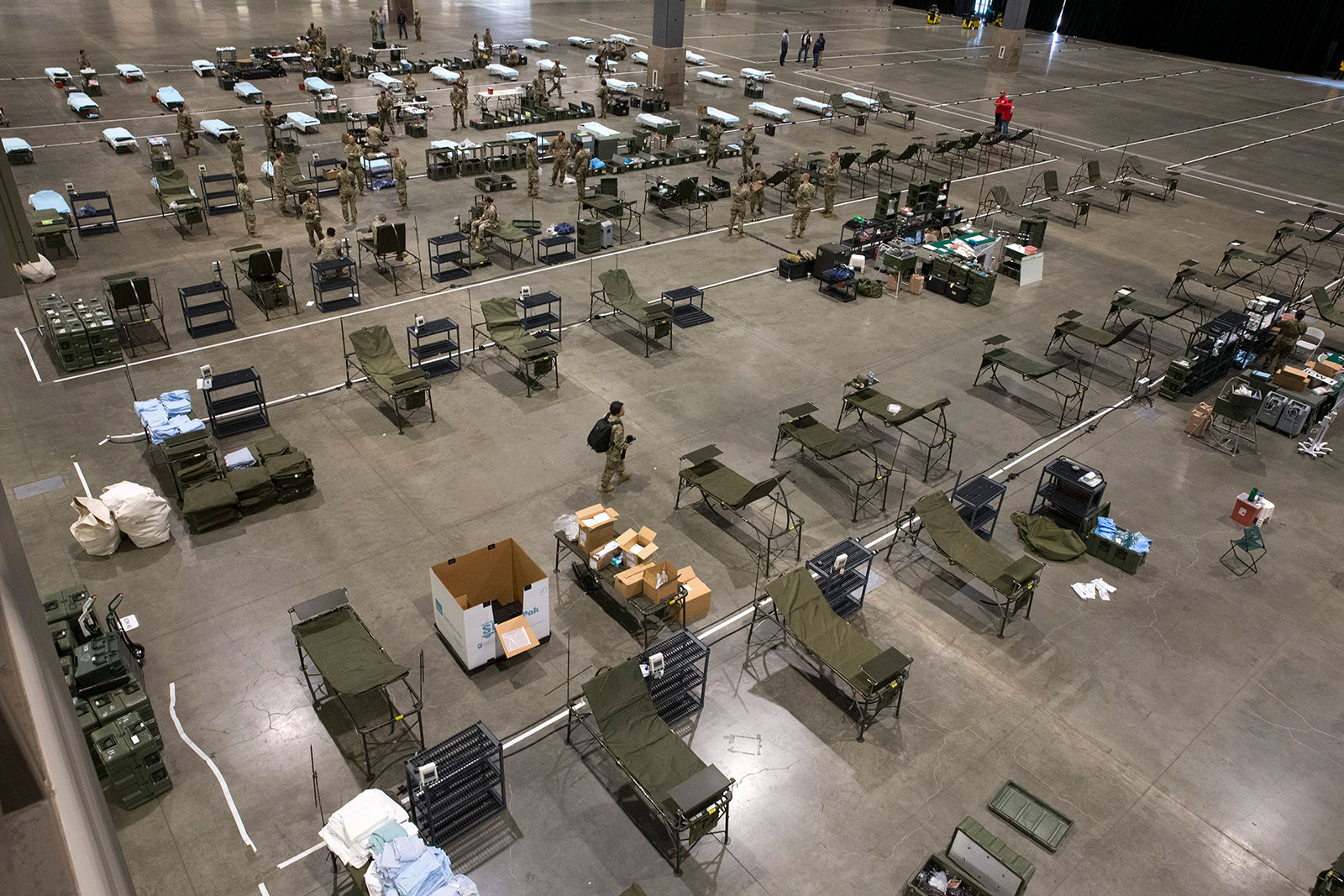 Military personnel set up a field hospital at CenturyLink Event Center on March 31.