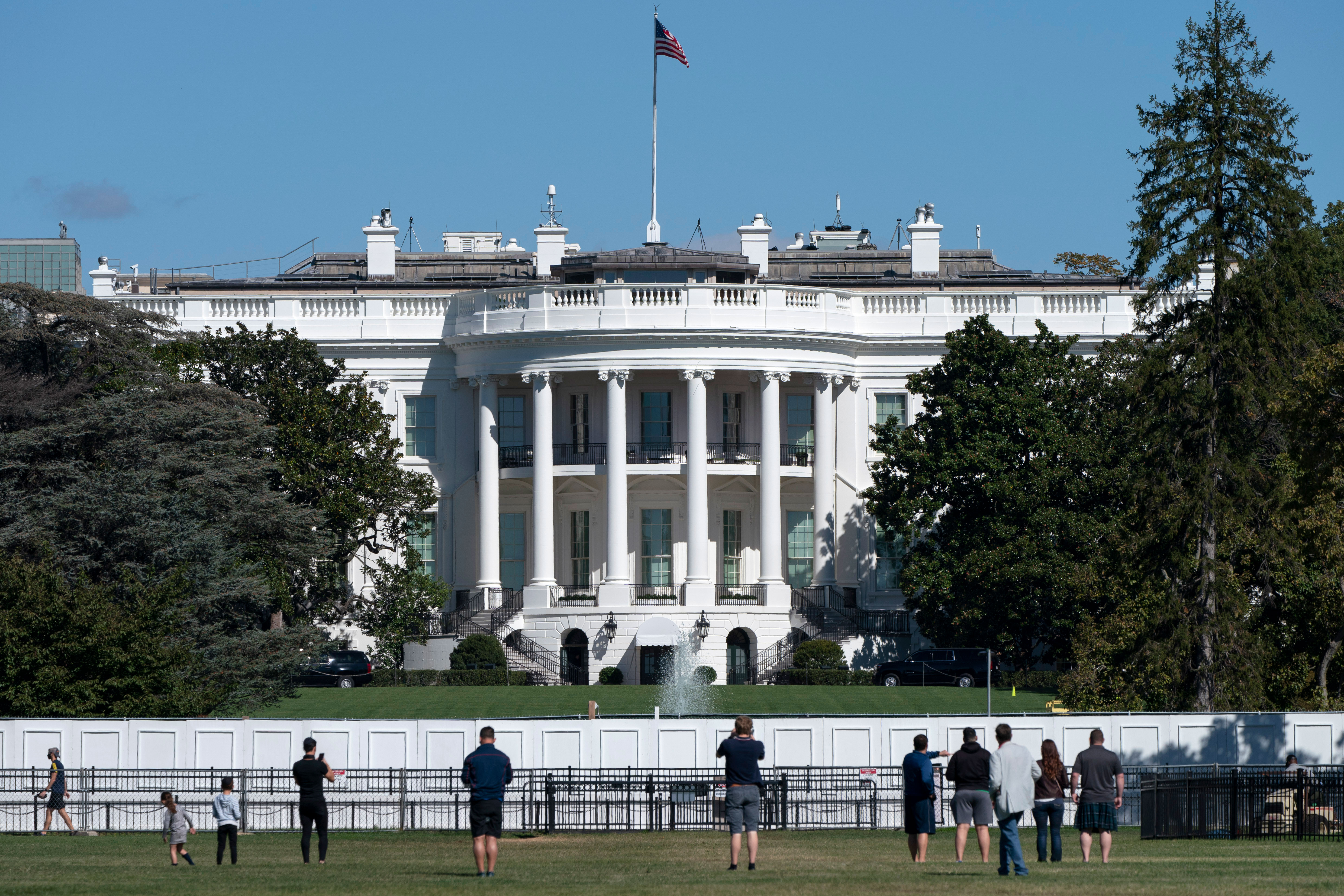 People take pictures of the White House on October 8.