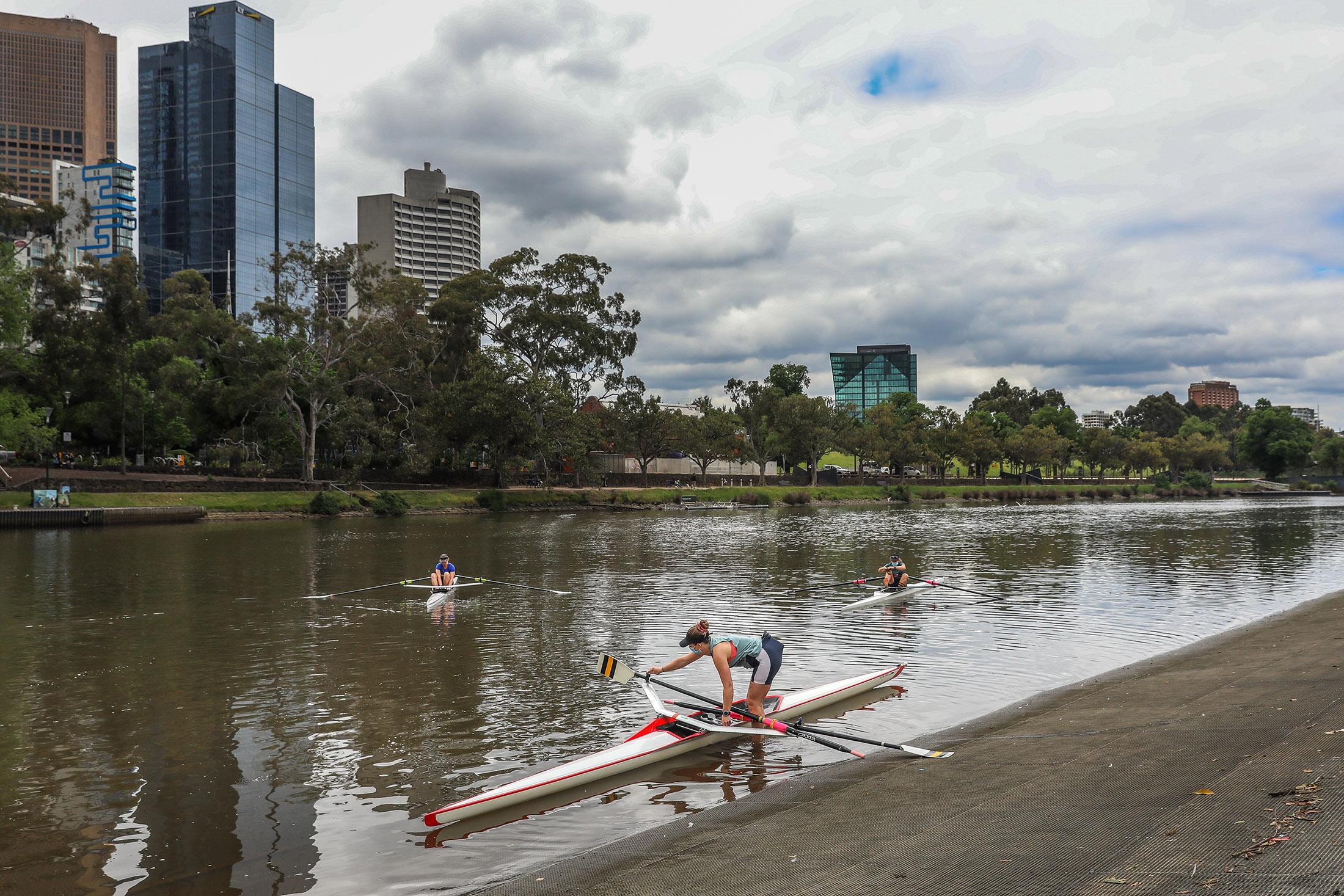 Rowers are seen about to leave the banks of the Yarra river as they go rowing on November 6, in Melbourne, Australia.