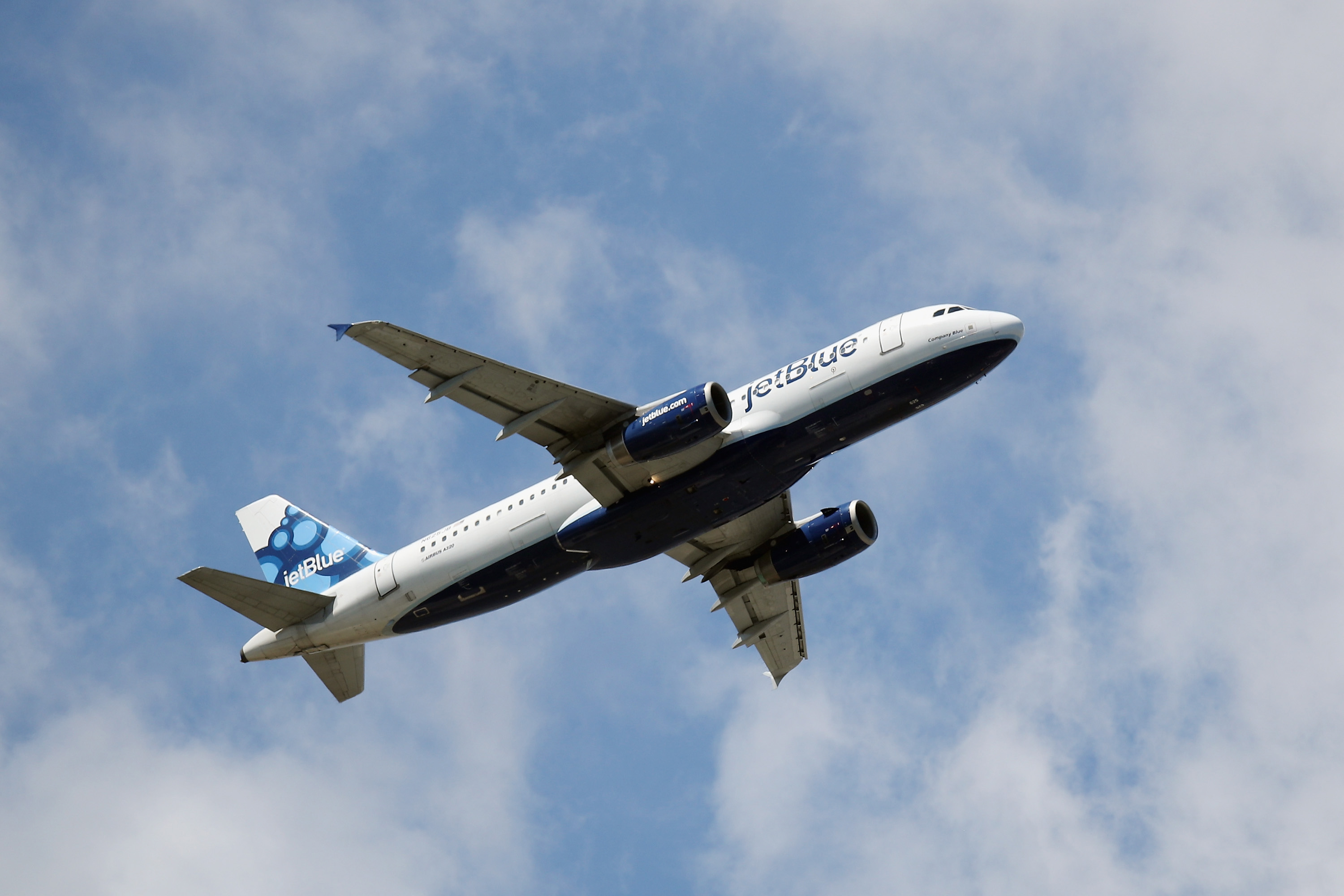 A plane operated by JetBlue takes off from JFK Airport on August 24, 2019 in the Queens borough of New York City.