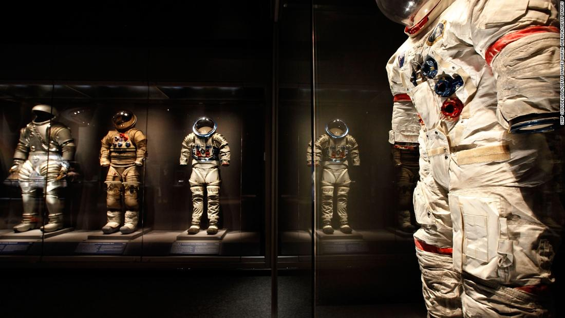 Several experimental prototypes of EVA (Extra Vehicular Activity) on display with a suit worn on the moon by Apollo 14 astronaut Alan Sheppard (R) in the Apollo Treasures Gallery at the Kennedy Space Center.