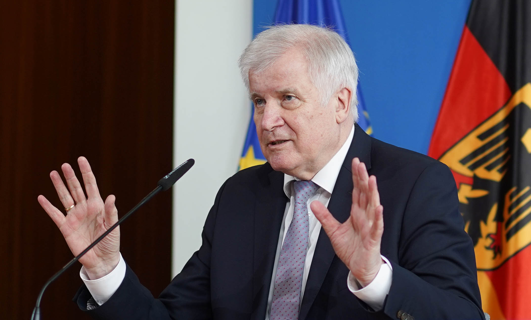 German Interior Minister Horst Seehofer speaks at a conference about the planned dismantling of Germany's border controls, in Berlin, on Wednesday, June 10.