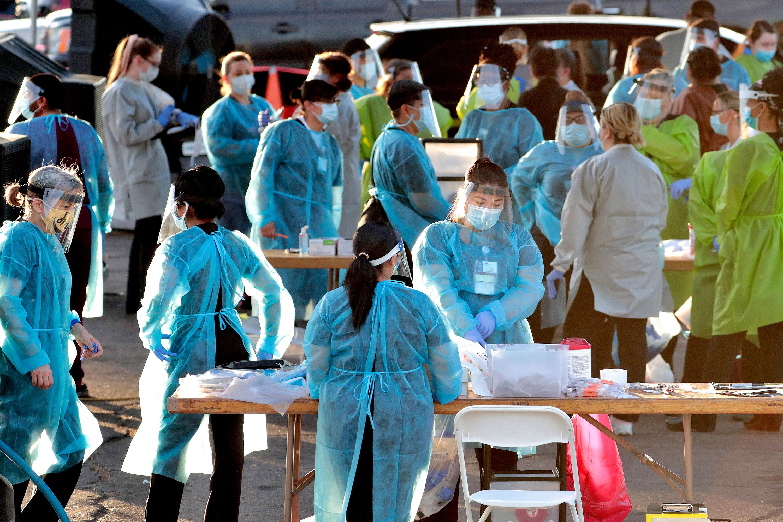 Medical personnel prepare to administer hundreds of coronavirus tests on June 27 in Phoenix, Arizona.